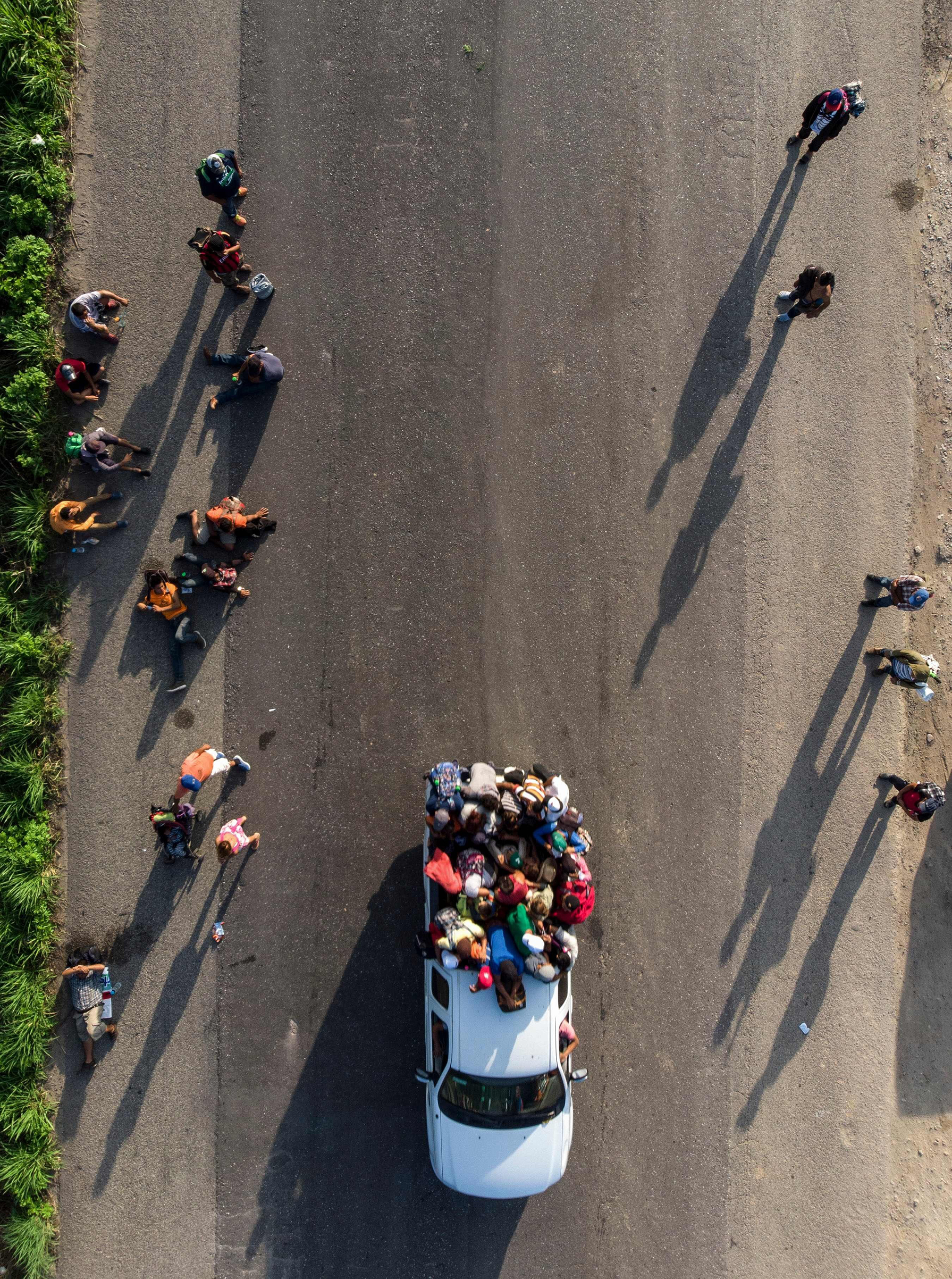 Honduran migrants, part of a caravan to the U.S., resume their march in Oaxaca State, Mexico, on Oct. 29