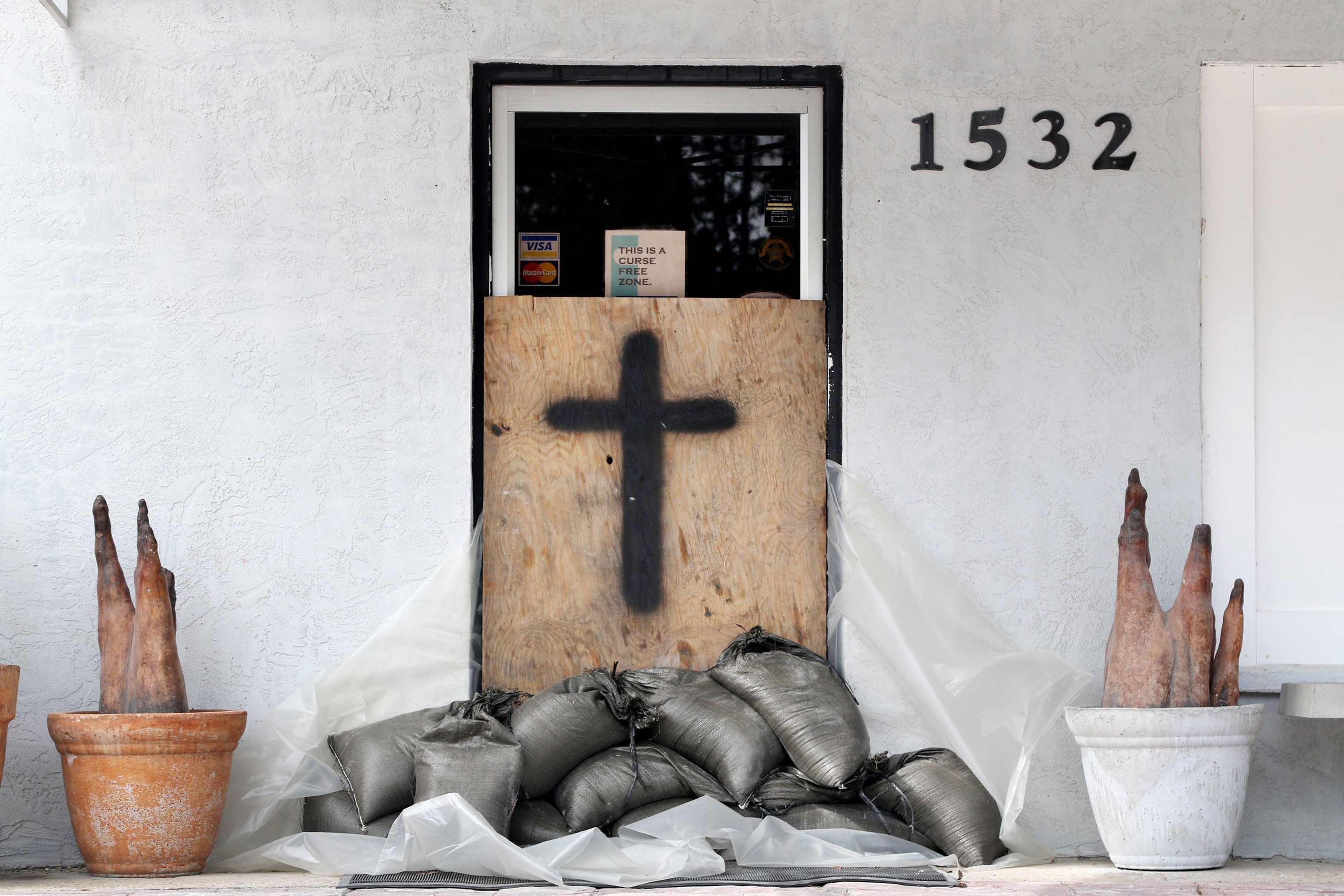 The front door of the Brooks Concrete business office is sandbagged in downtown Panacea, Fla. on Oct. 9, 2018 as Hurricane Michael churns toward the Florida Panhandle.