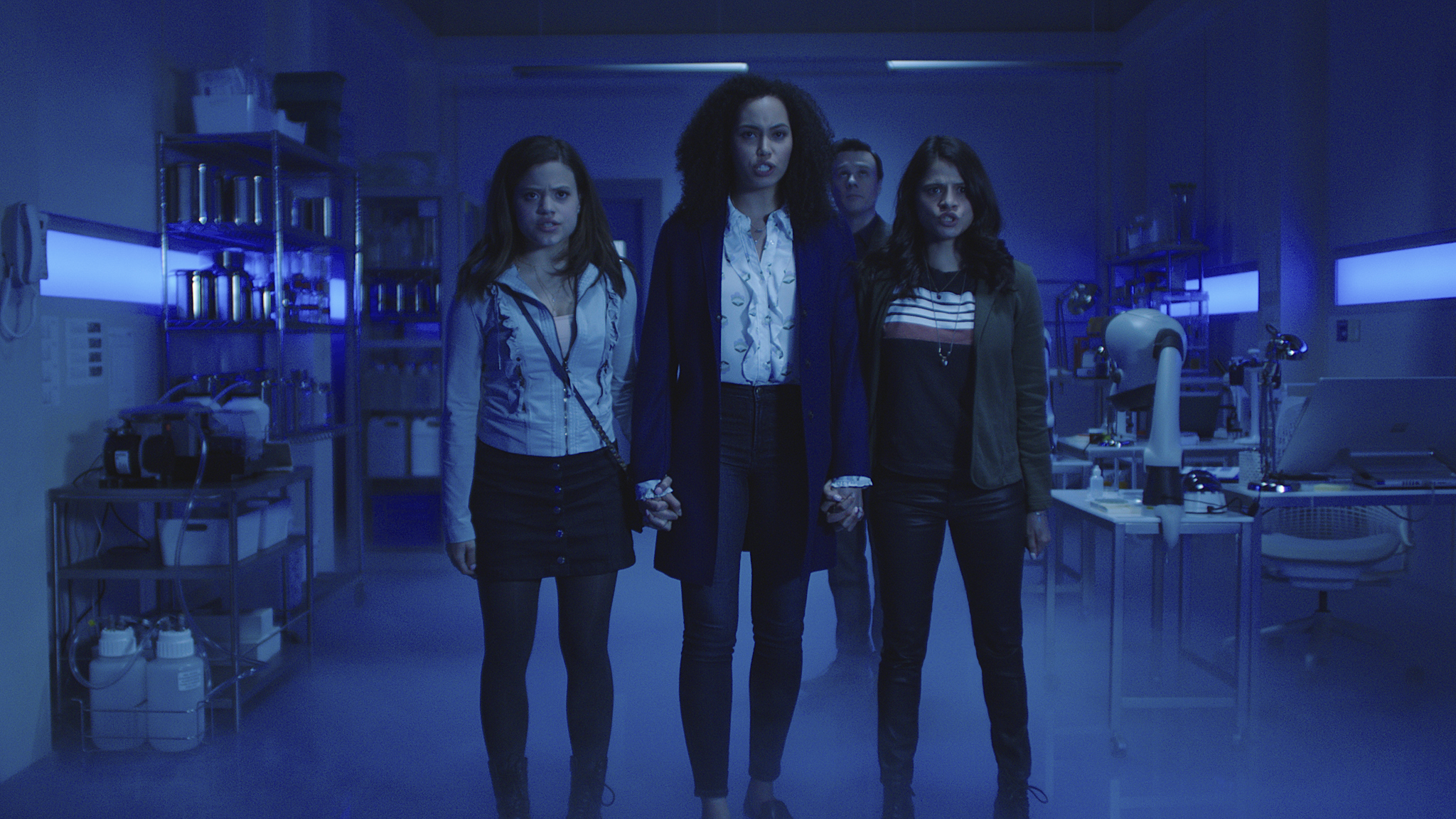 Screen grab from the pilot episode of Charmed. Pictured (L-R): Sarah Jeffery as Maggie Vera, Madeleine Mantock as Macy Vaughn, Rupert Evans as Harry Greenwood and Melonie Diaz as Mel Vera