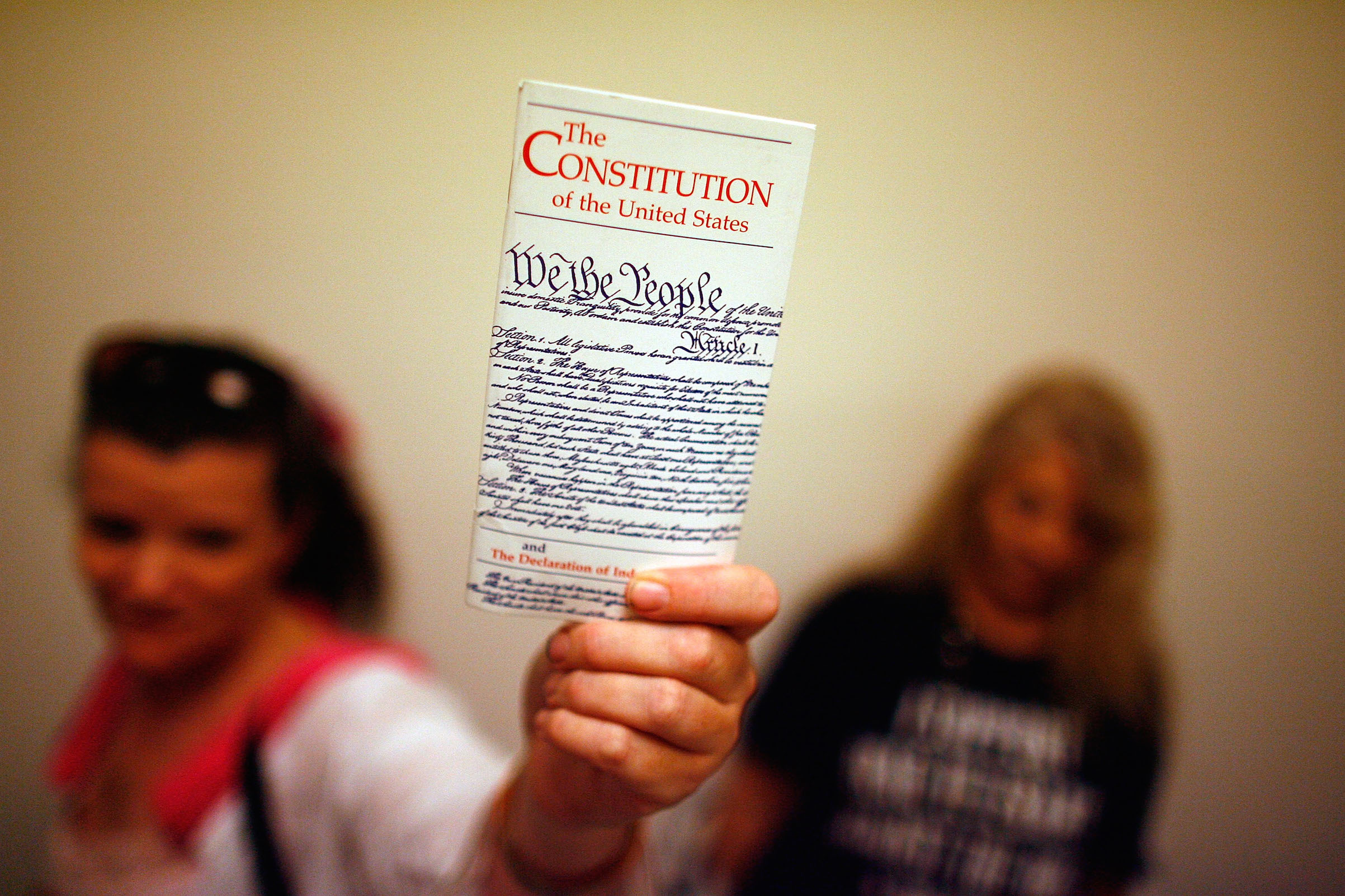 Lisa Petry of Virginia Beach, Va., holds up a copy of the U.S. Constitution while waiting in line to attend the House Judiciary Committee hearing on the  Executive Power and Its Constitutional Limitations  on Captiol Hill in 2008 in Washington, DC.