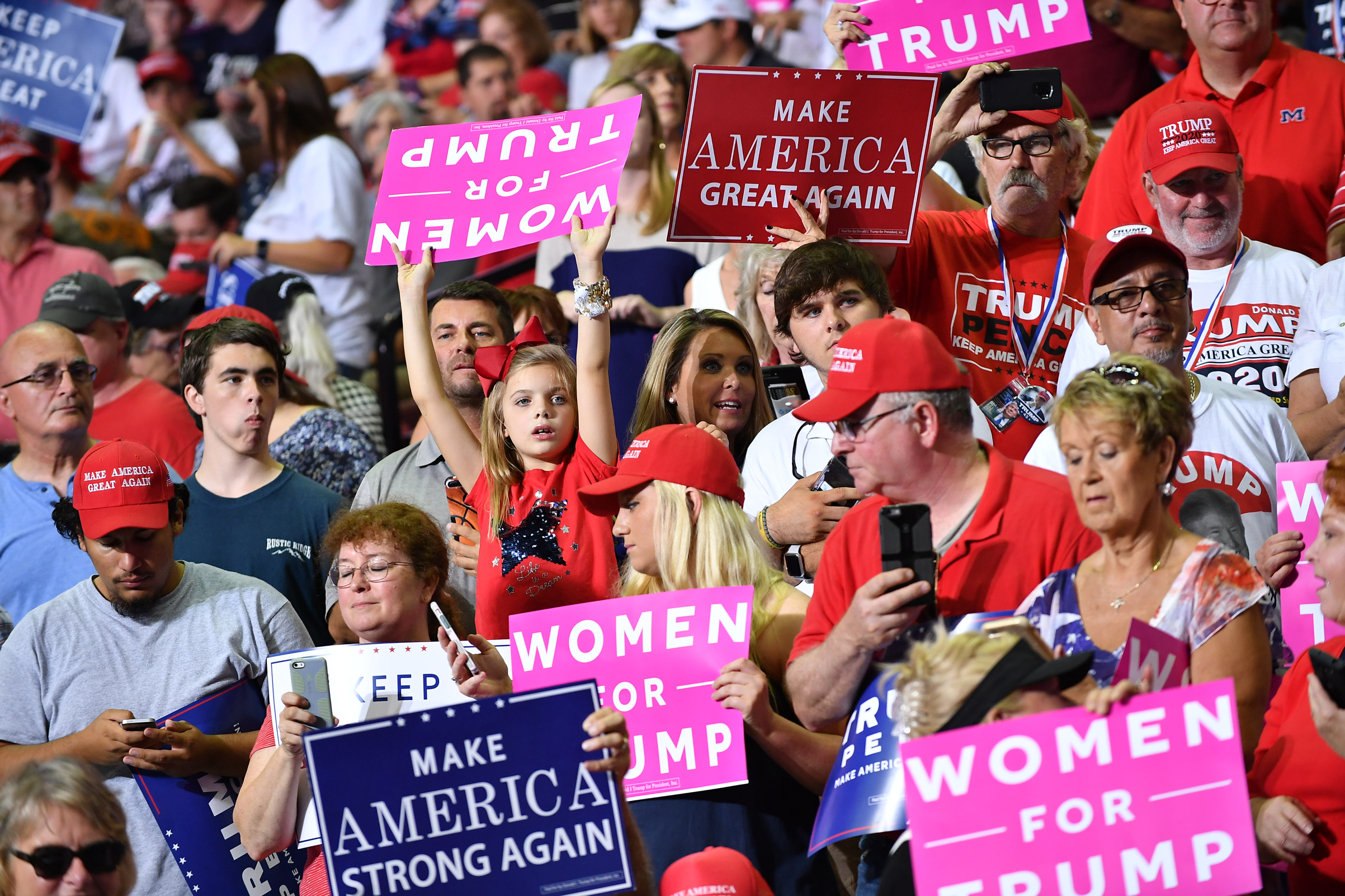 Supporters of President Donald Trump attend a 'Make America Great Again' rally in Southaven, Miss., on Oct. 2, 2018.