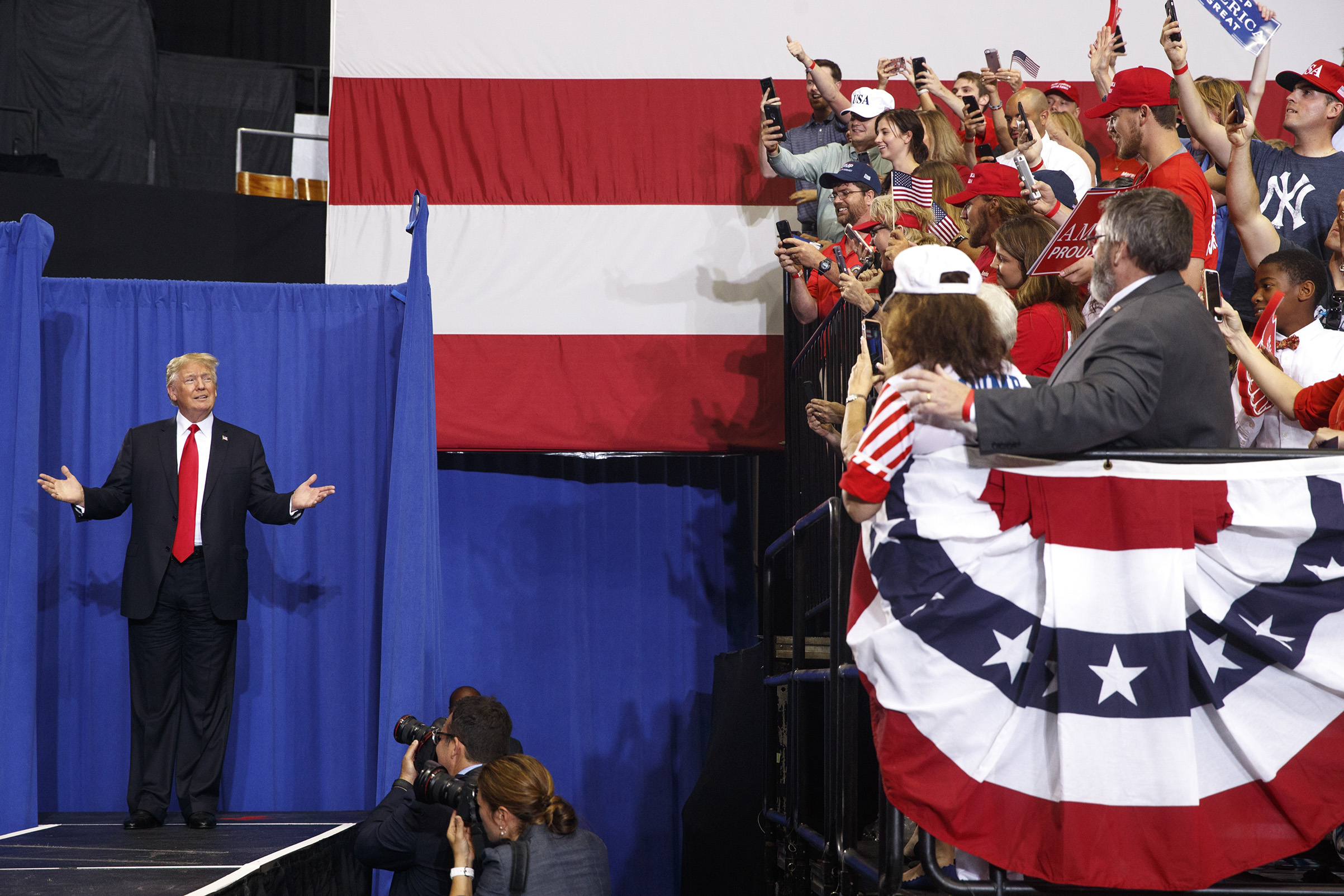 President Donald Trump arrives on stage at a campaign-style rally at the Nashville Municipal Auditorium in Nashville, Tenn., May 29, 2018.