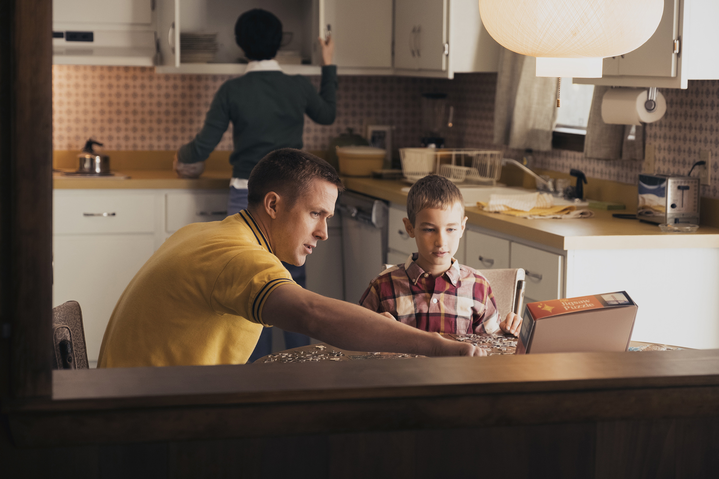 The moon and the home pulled Apollo astronauts in opposite directions. Armstrong (Gosling), with his wife and son in their Houston kitchen, suffered that more than most.