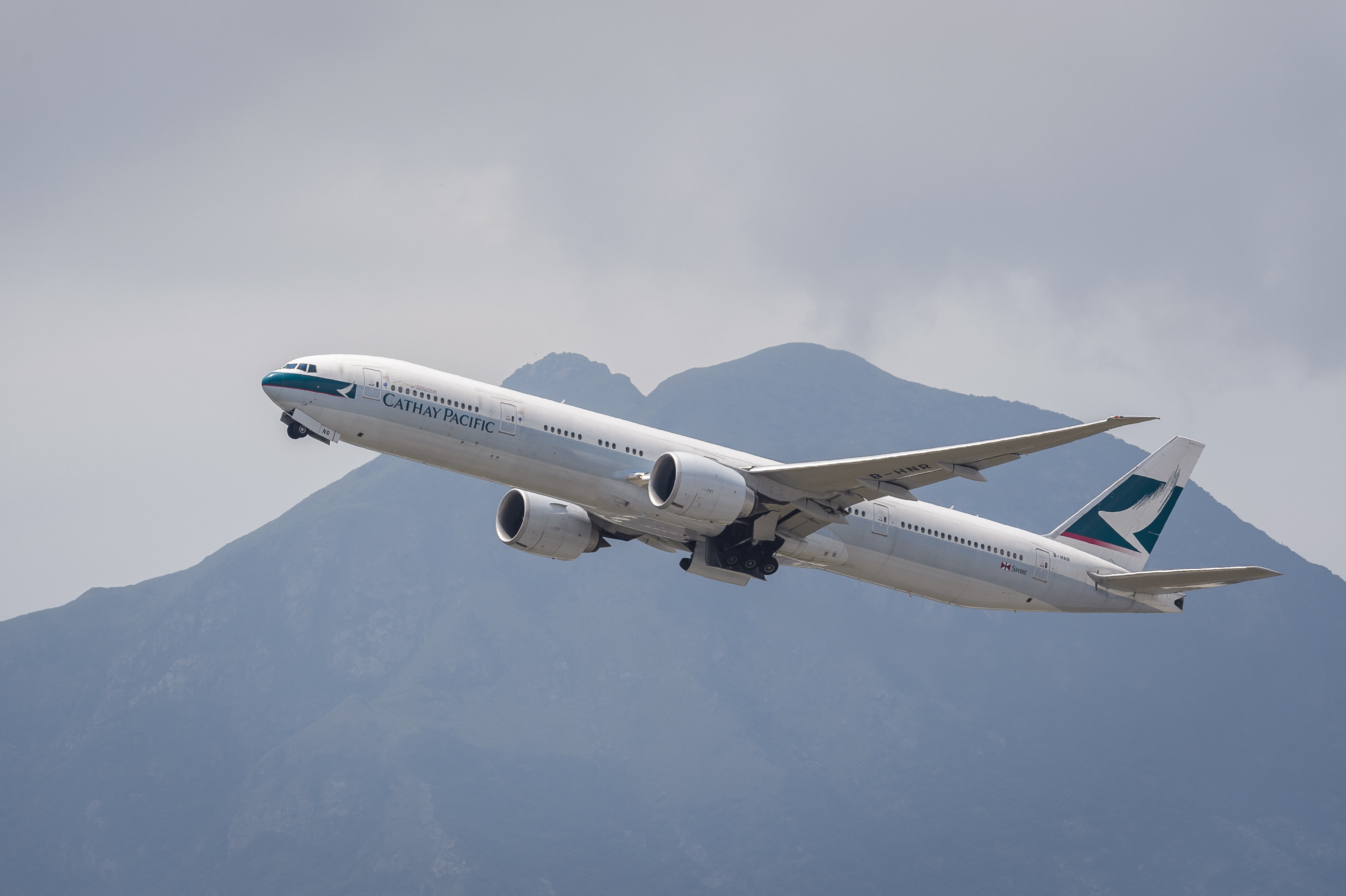A Boeing 777-367(ER) passenger plane belonging to Cathay Pacific takes off from the Hong Kong International Airport in Hong Kong on Aug. 08 2018.