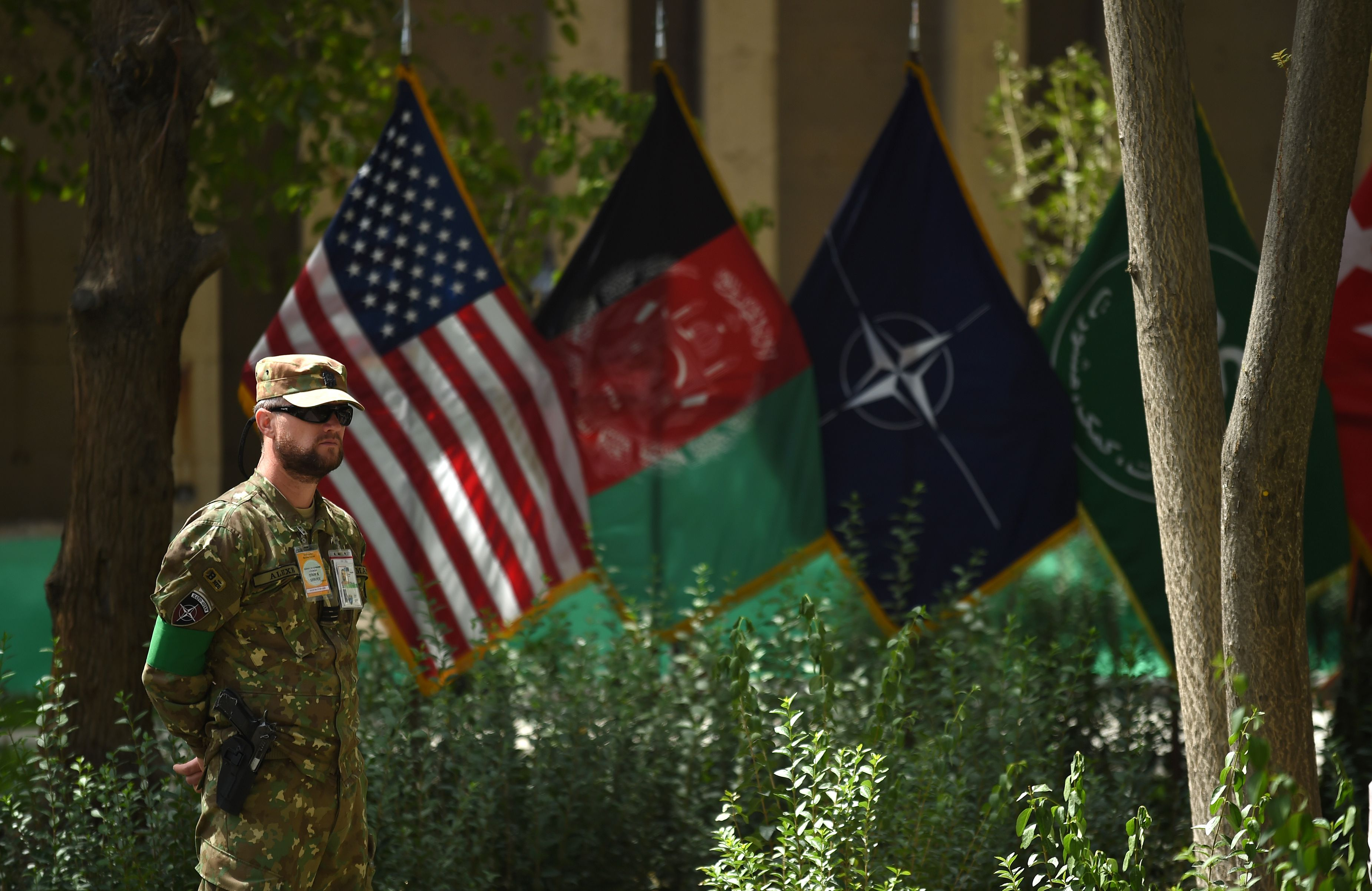 A member of the NATO military forces stands guard during a change of command ceremony at Resolute Support in Kabul, Afghanistan on Sept. 2, 2018.