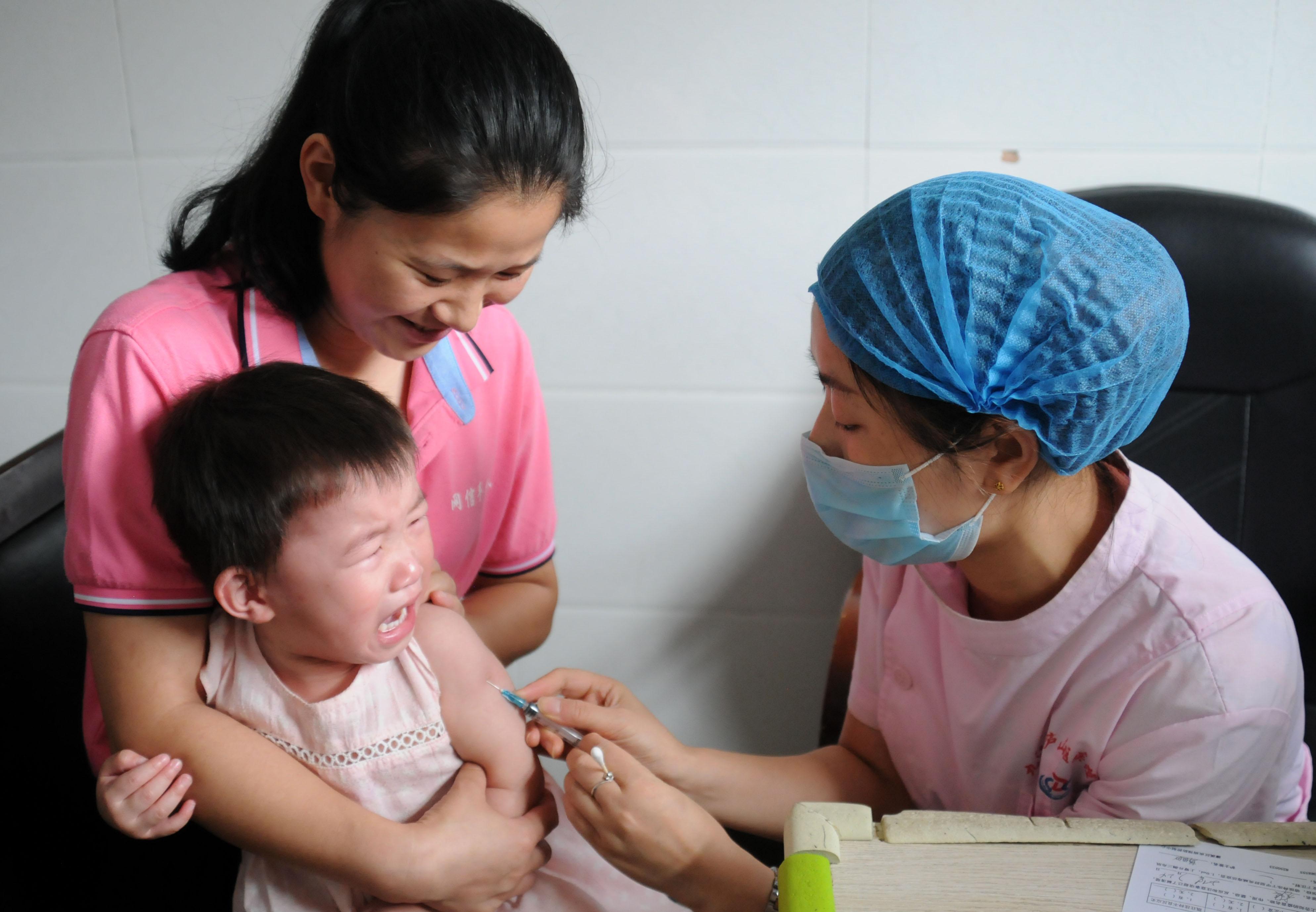 A child receives a vaccination on July 24, 2018 in Jiujiang, Jiangxi Province. China.