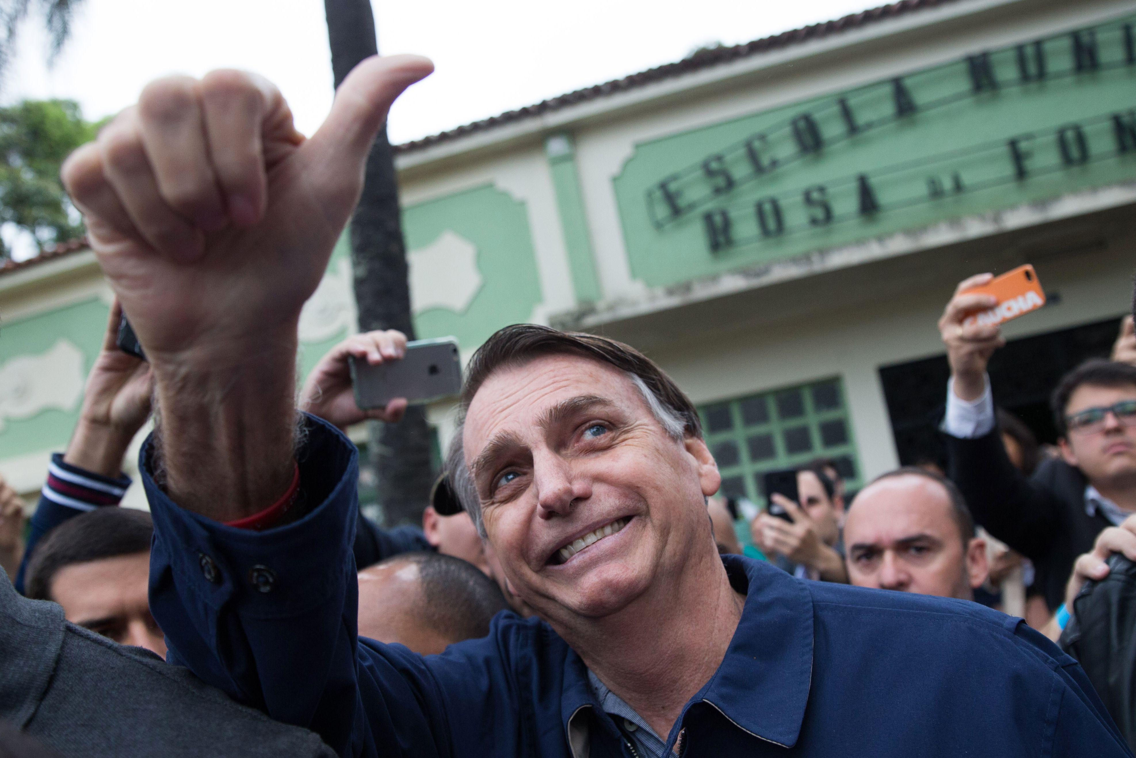 Brazil's right-wing presidential candidate for the Social Liberal Party (PSL) Jair Bolsonaro gives his thumbs up after casting his vote at Villa Militar, during general elections, in Rio de Janeiro, Brazil, on Oct. 7, 2018.