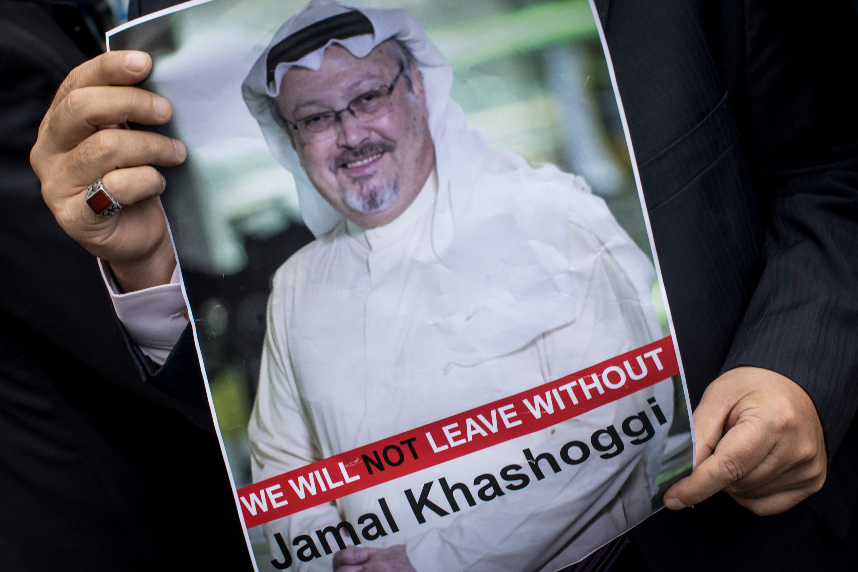 A man holds a poster of Saudi journalist Jamal Khashoggi during a protest organized by members of the Turkish-Arabic Media Association at the entrance to Saudi Arabia's consulate  in Istanbul, Turkey on Oct. 8, 2018.