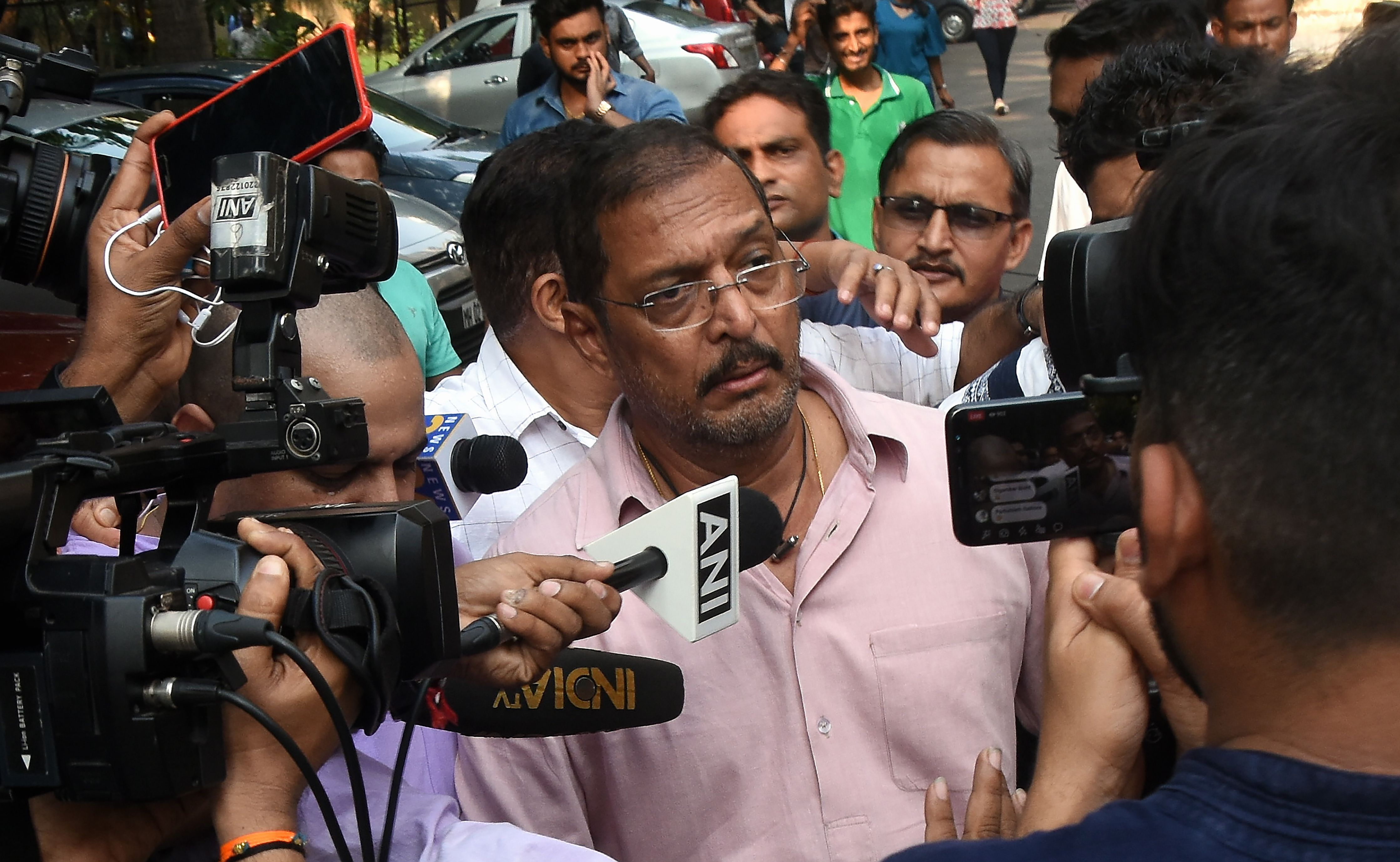 Indian Bollywood actor Nana Patekar is mobbed by the media as he leaves after making a statement outside his home in Mumbai on October 8, 2018. Actress Tanushree Dutta, whose recent public account of alleged sexual harassment by Patekar has sparked an outpouring of similar #MeToo accounts across the country, has filed a formal complaint.