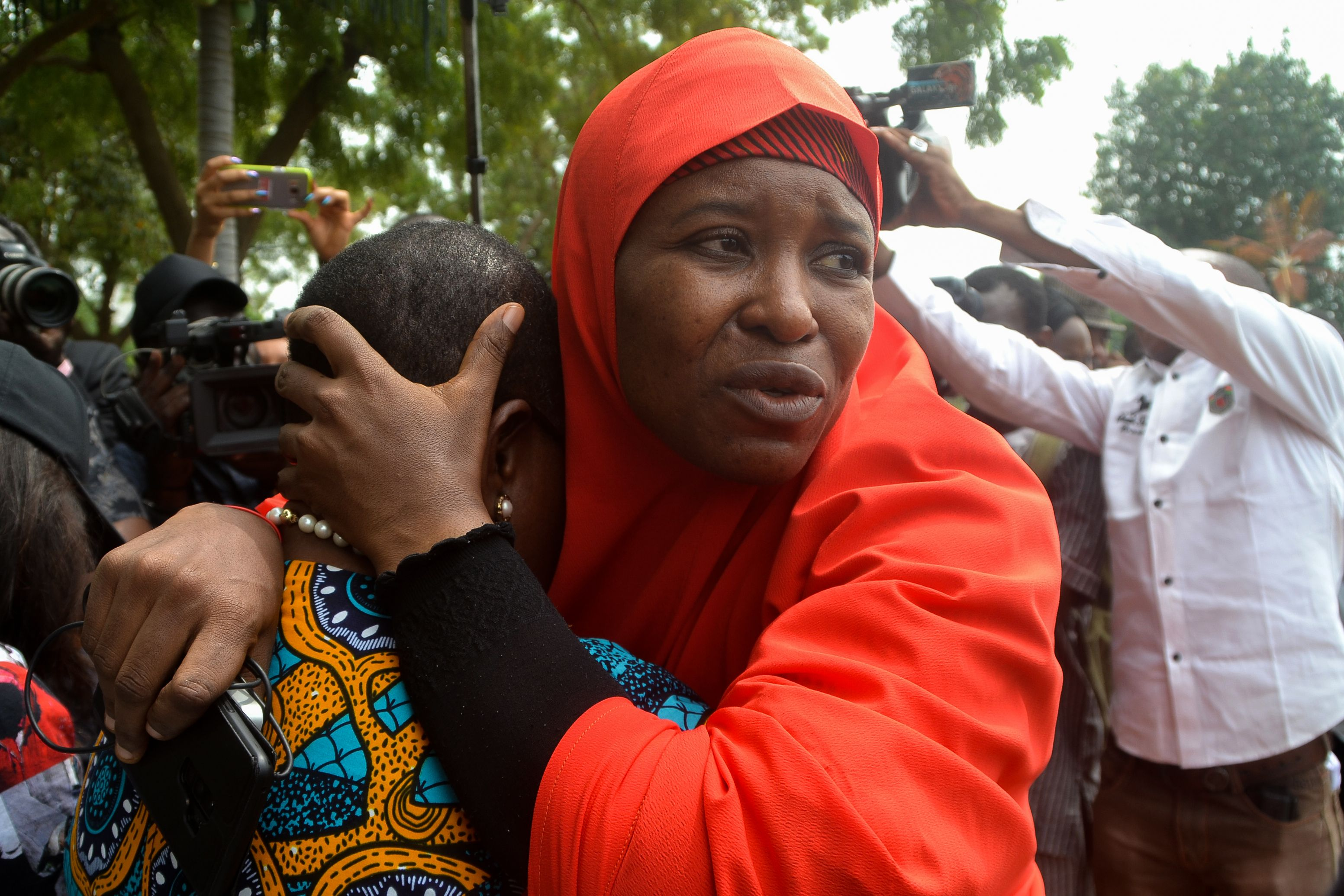 Founder of the Bring Back Our Girls (BBOG) advocacy group Oby Ezekwesili is comforted during a protest in Abuja, Nigeria on Oct. 16, 2018, following the killing of a kidnapped female Red Cross worker by Islamic State-allied Boko Haram jihadists.