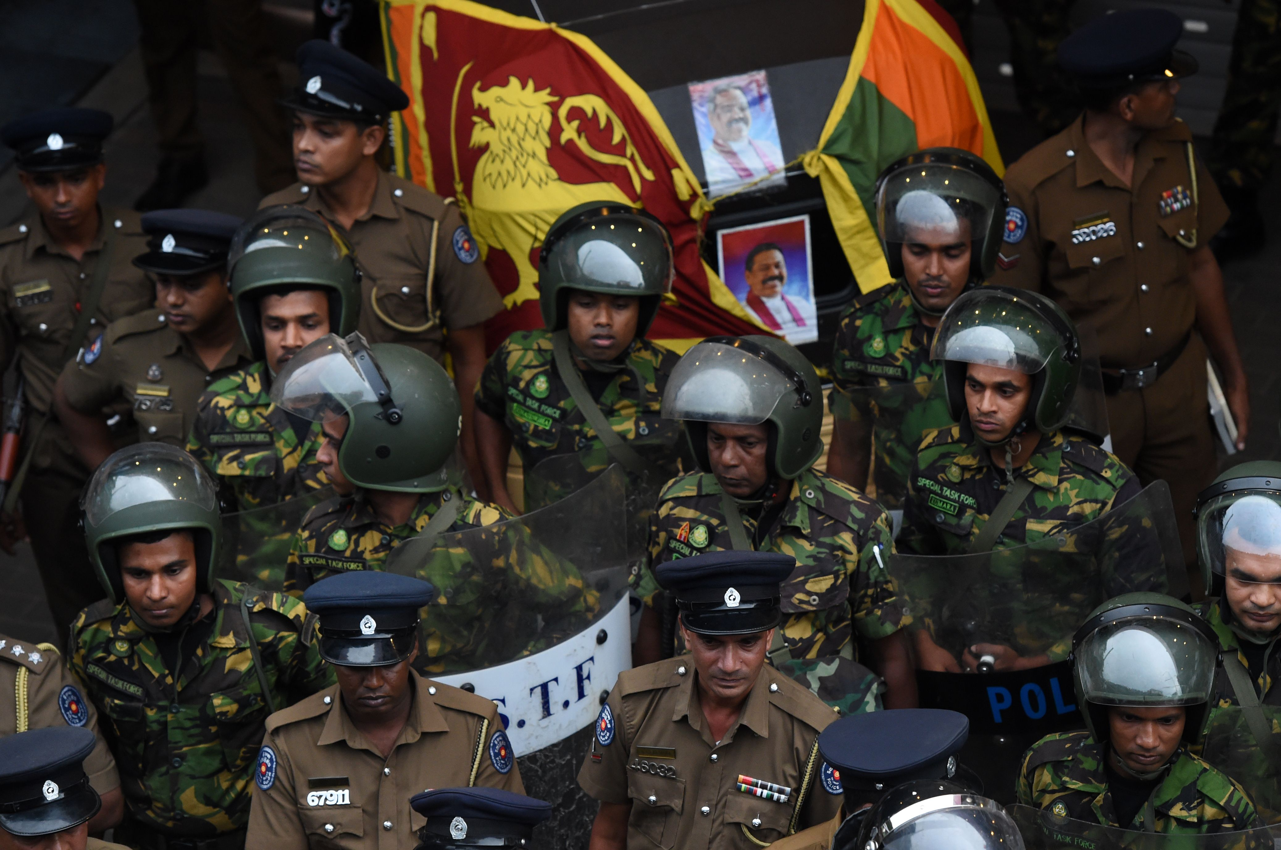 Sri Lankan soldiers keep watch outside the ceylon petroleum corporation in Colombo on October 28, 2018. - A constitutional crisis gripping Sri Lanka since the president's shock dismissal of Prime Minister Ranil Wickremesinghe erupted into violence on October 28, with a man shot dead and two others injured in Colombo. (Photo by ISHARA S.  KODIKARA / AFP)        (Photo credit should read ISHARA S.  KODIKARA/AFP/Getty Images)