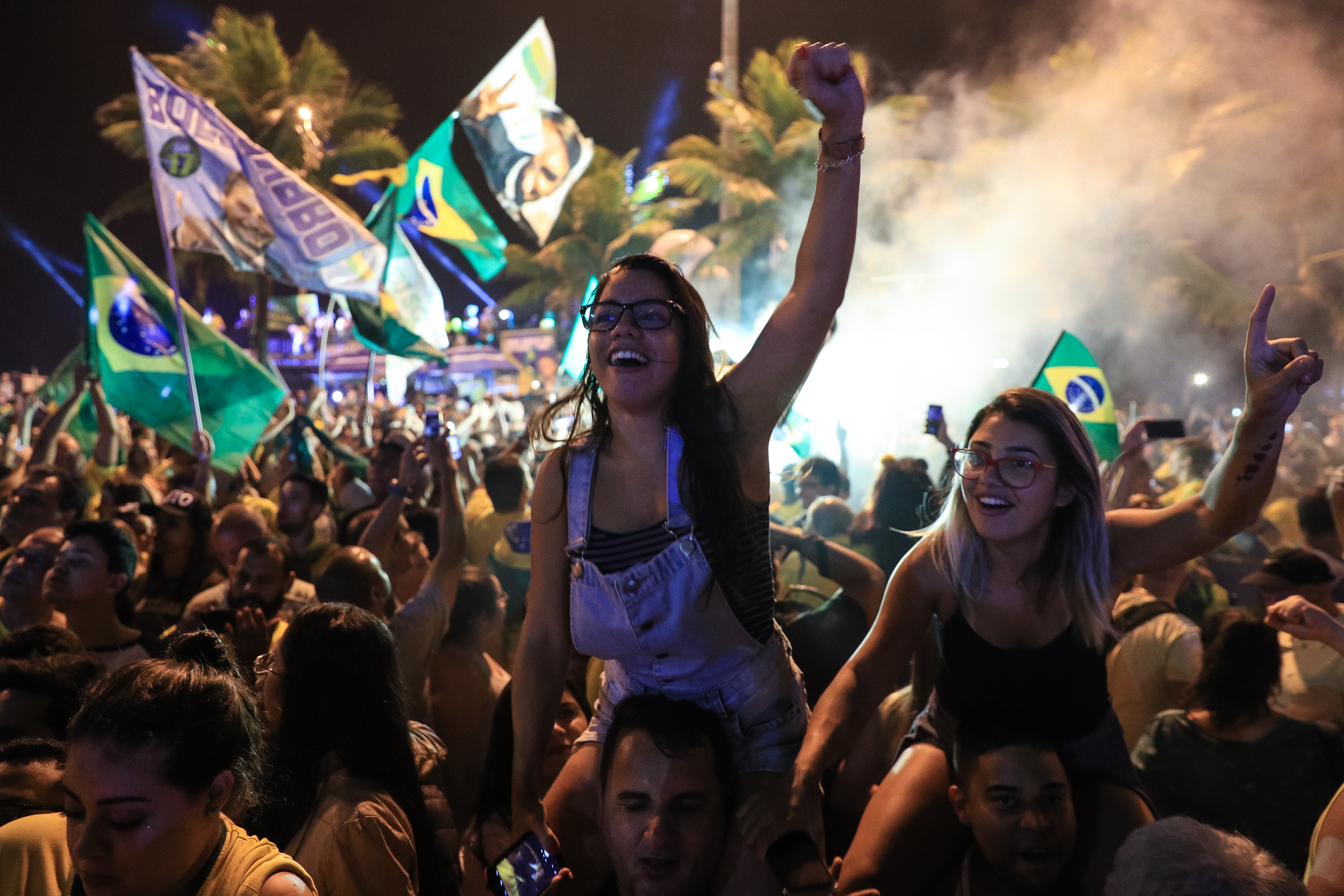 Supporters of far-right presidential candidate Jair Bolsonaro, celebrate in front of his house in Rio de Janeiro, Brazil, after he won Brazil's presidential election, on Oct. 28, 2018 in Rio de Janeiro, Brazil