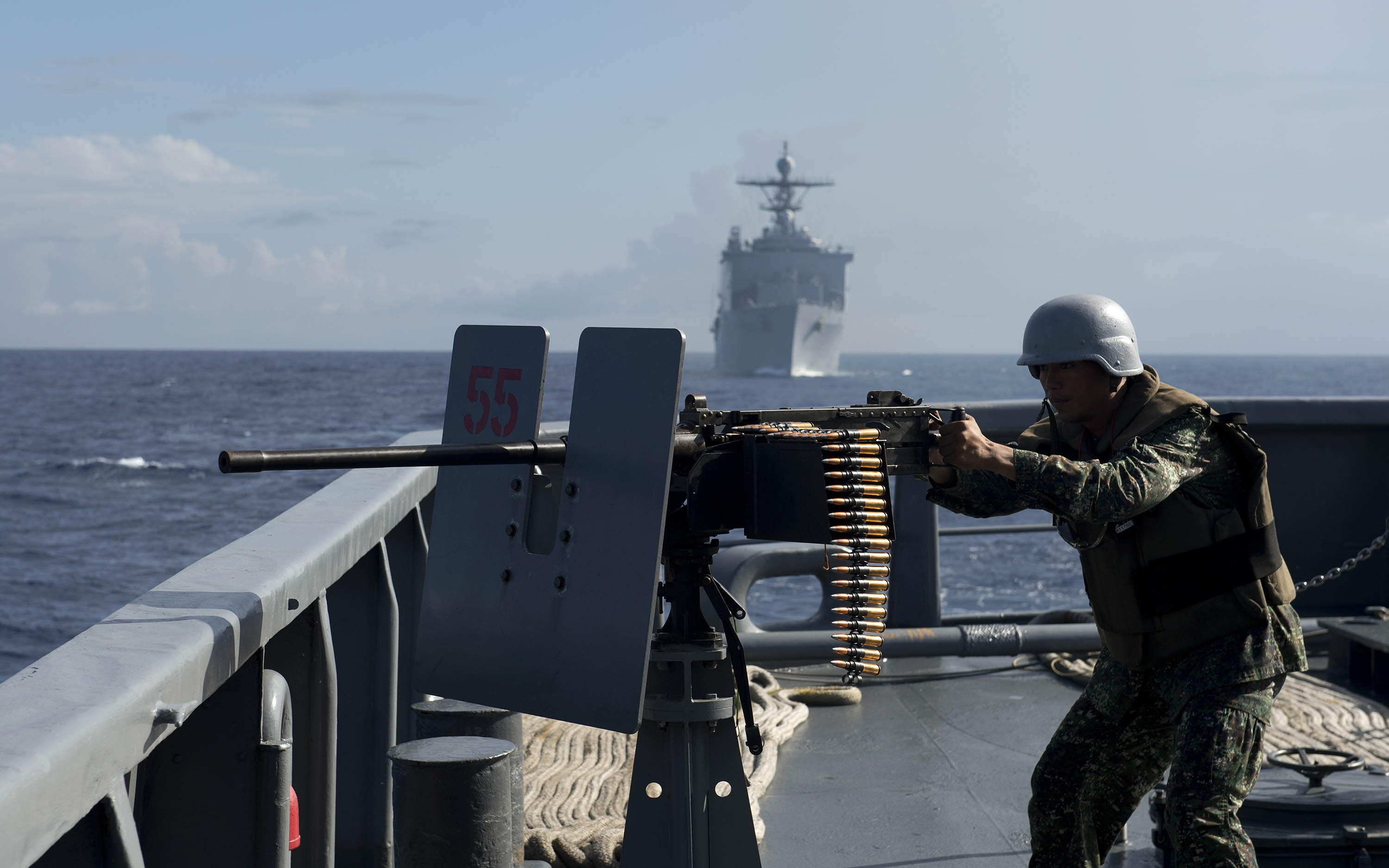A Philippine Navy personnel mans a .50 caliber machine gun during the bilateral maritime exercise between the Philippine Navy and US Navy innear waters claimed by Beijing  the South China Sea on June 29, 2014.