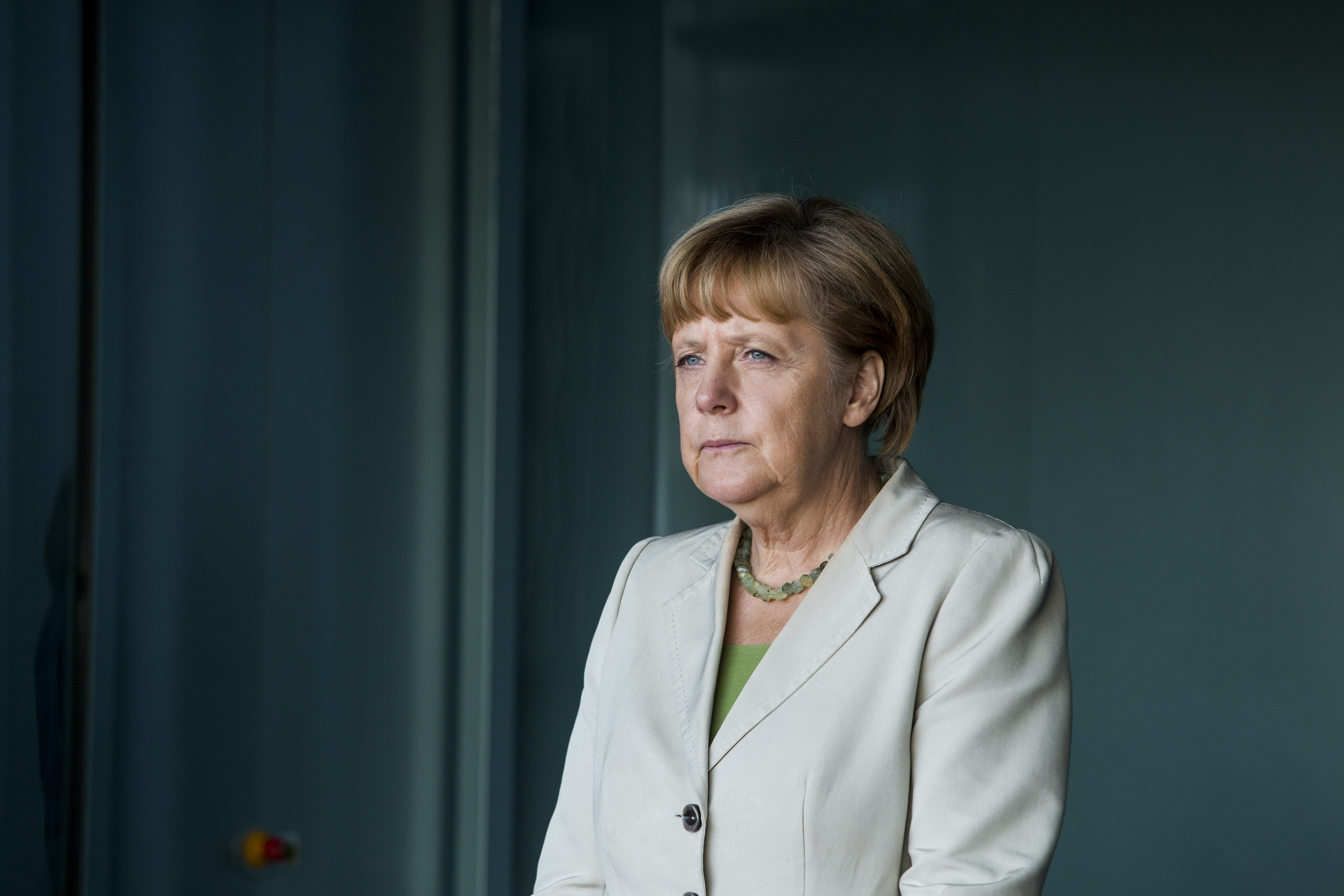 AUG 28: German Chancellor Angela Merkel waits for delegates at the German government Balkan conference in Berlin