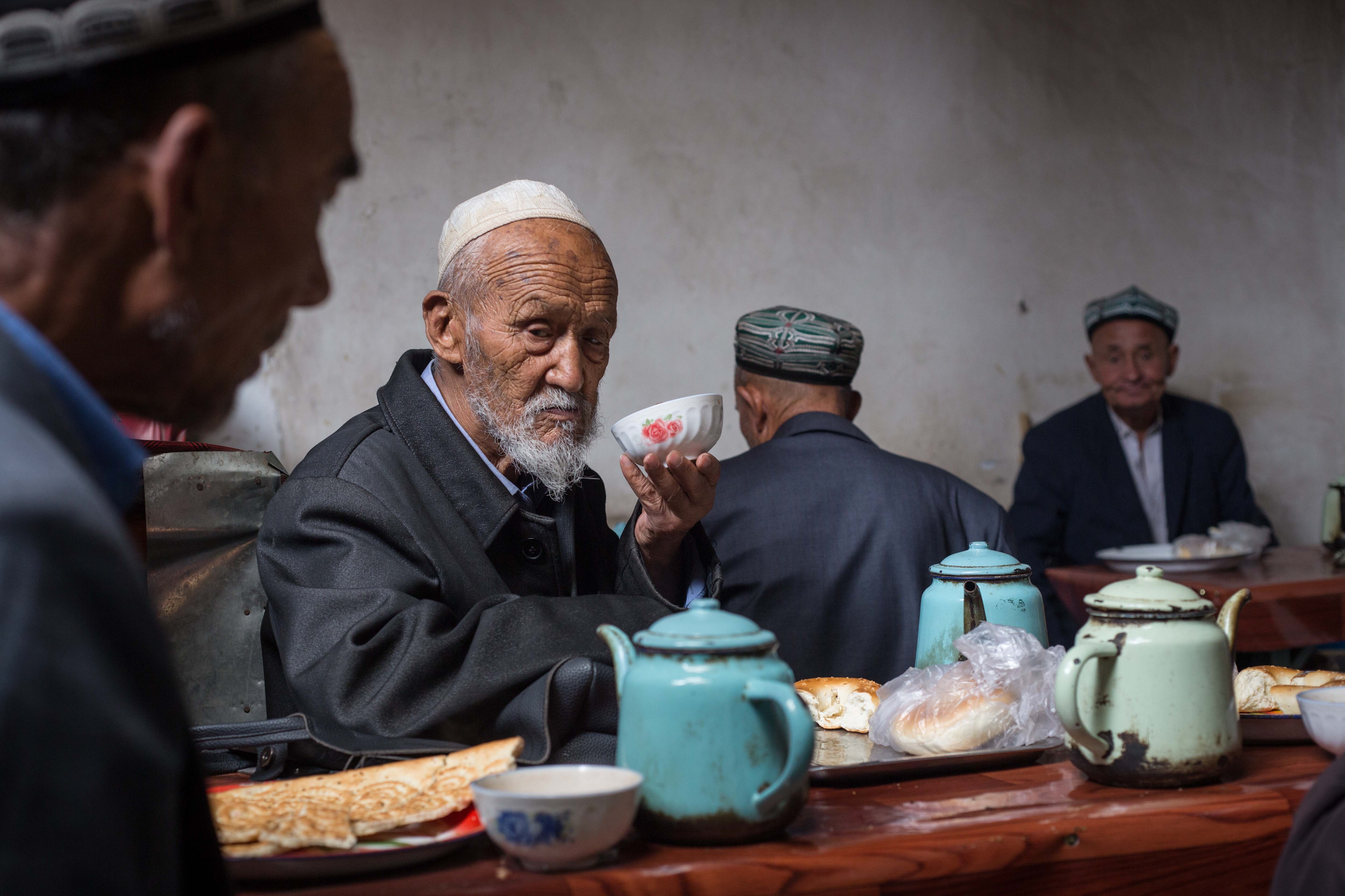 A Uighur man drinks tea at a local tea shop in Kashgar City, in China's Xinjiang Uyghur Autonomous Region on July 06, 2017.