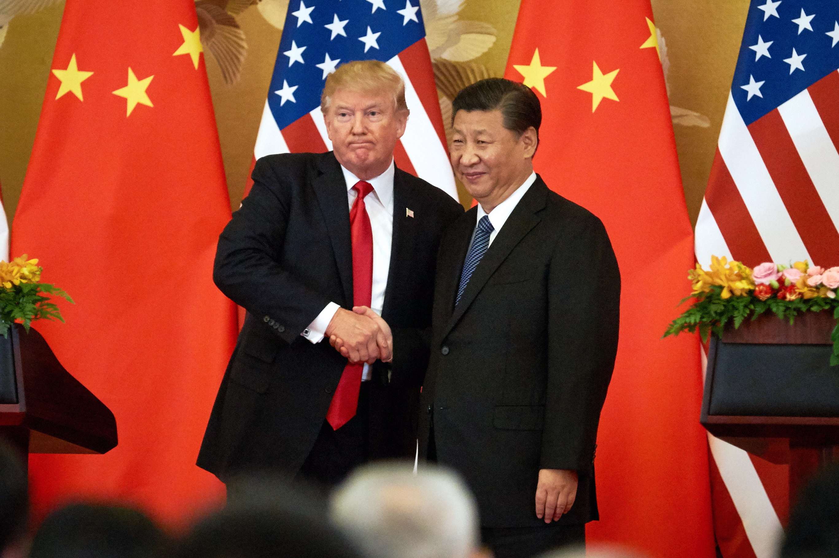 US President Donald Trump (L) and China's President Xi Jinping shake hands at a press conference following their meeting at the Great Hall of the People in Beijing.