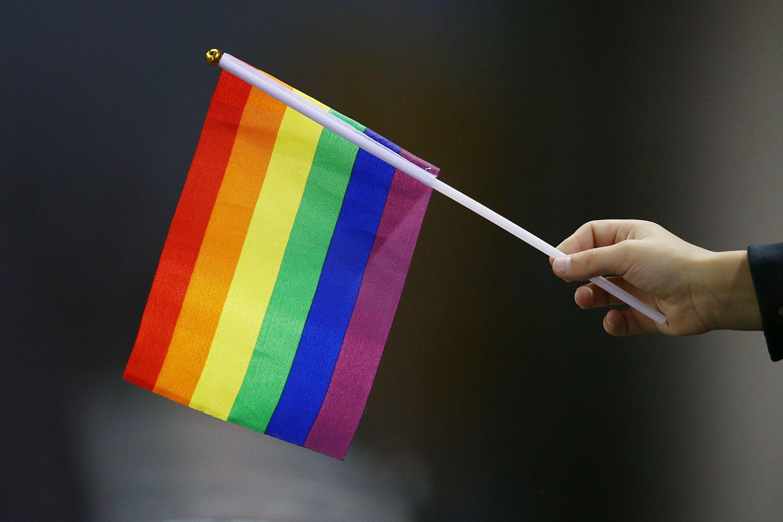 A rainbow gay pride flag is seen during an Australian Football League match on June 9, 2018 in Melbourne, Australia.