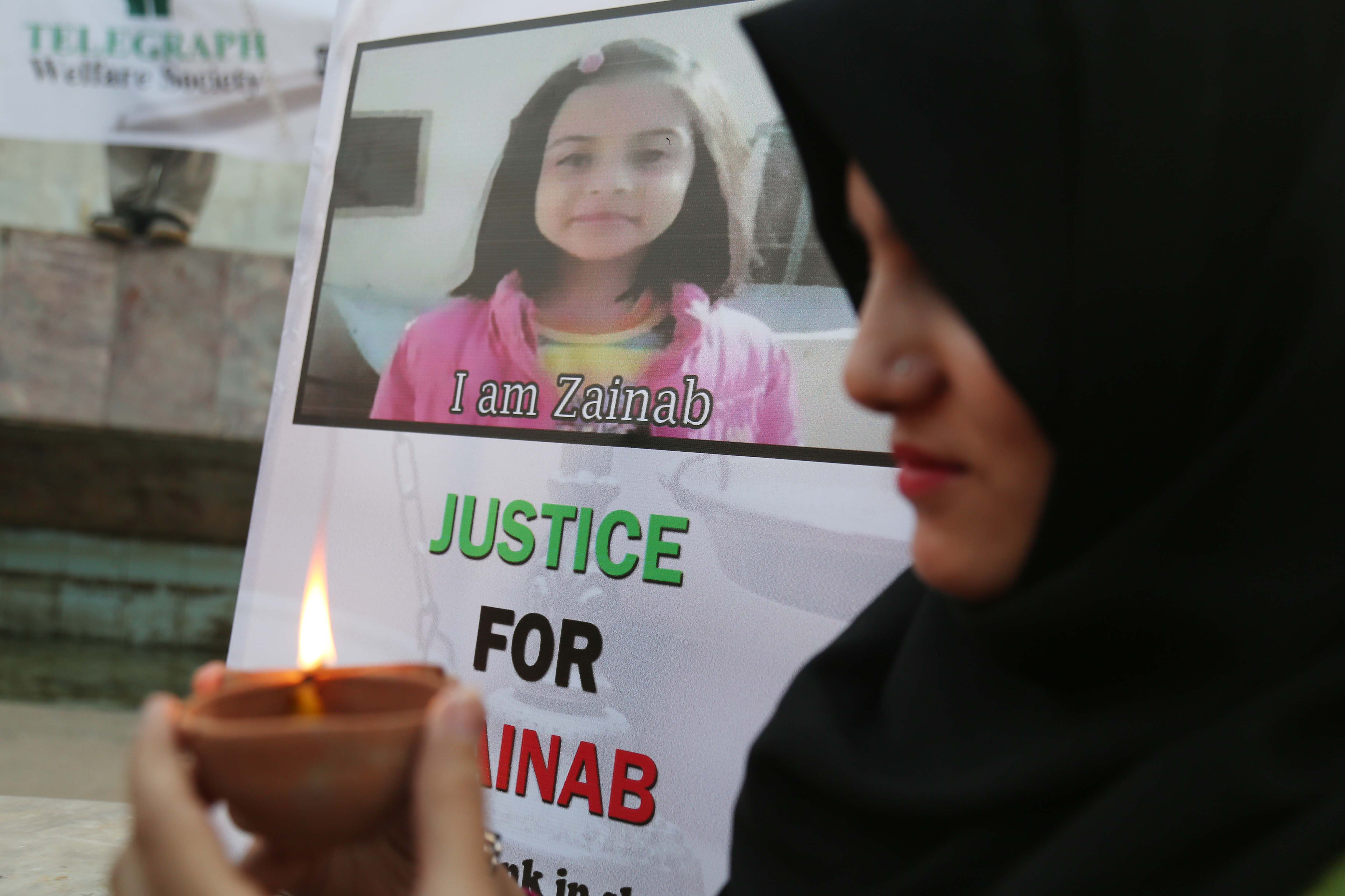 People light earthen lamps during a protest against the rape and murder of a Zainab Ansari in Kasur, Pakistan on Jan. 12 2018.