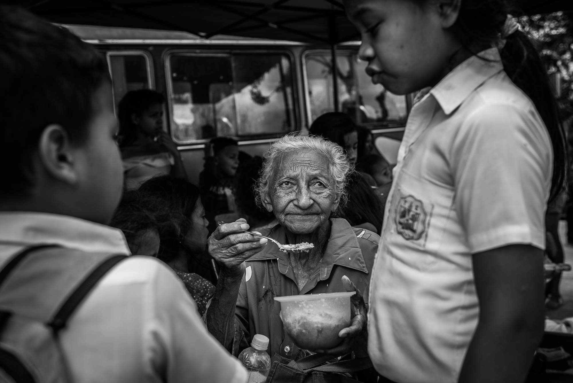 A grandmother feeds her grandchild at a charity kitchen run by volunteers and the NGO Caracas Mi Convive in East Caracas.