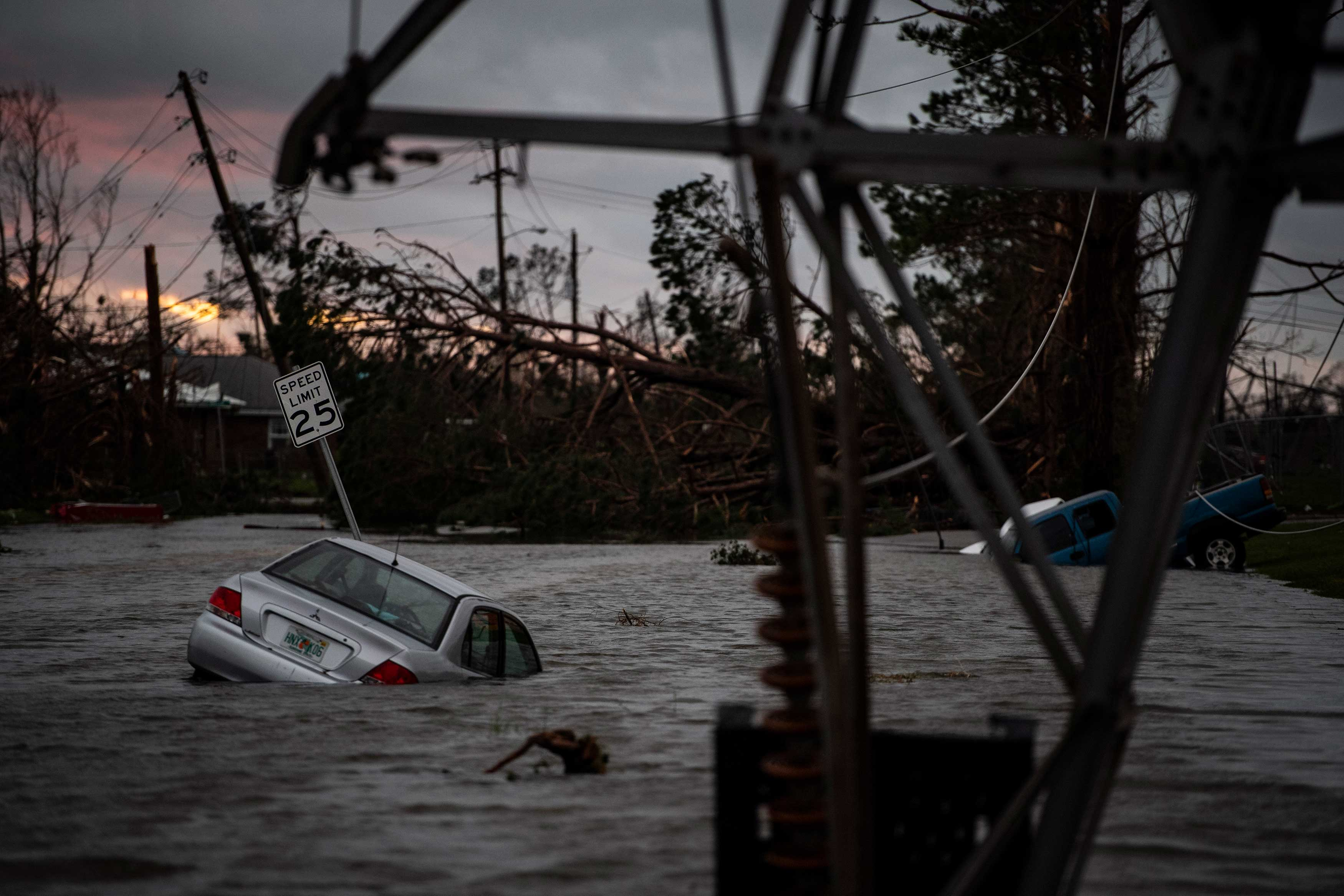 A car is seen caught in flood water after category 4 Hurricane Michael made land fall along the Florida panhandle, on Oct. 10, 2018 in Panama City, Fla.