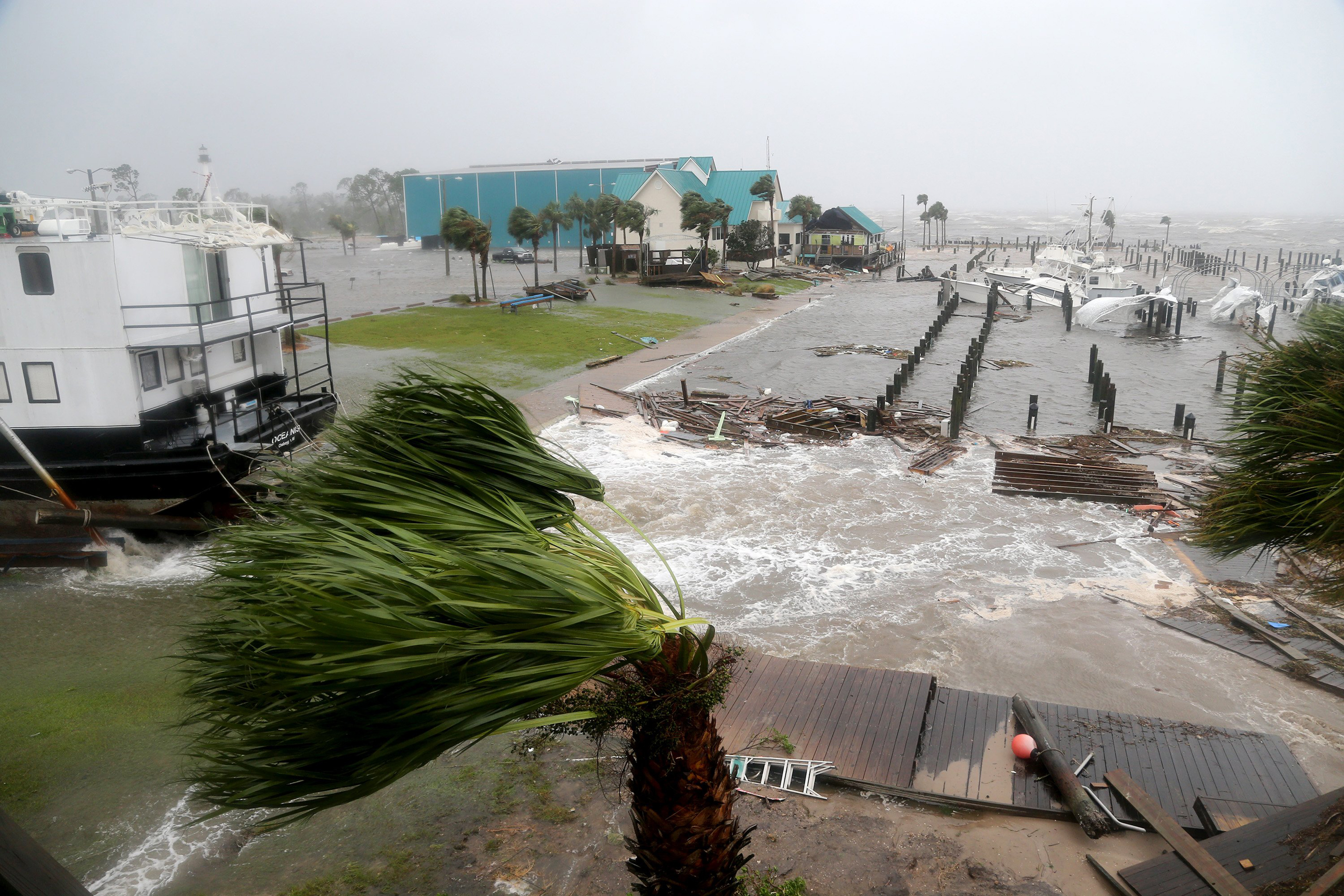 Boats lay sunk and damaged at the Port St. Joe Marina in the Florida Panhandle on Oct. 10 after Hurricane Michael made landfall near Mexico Beach.