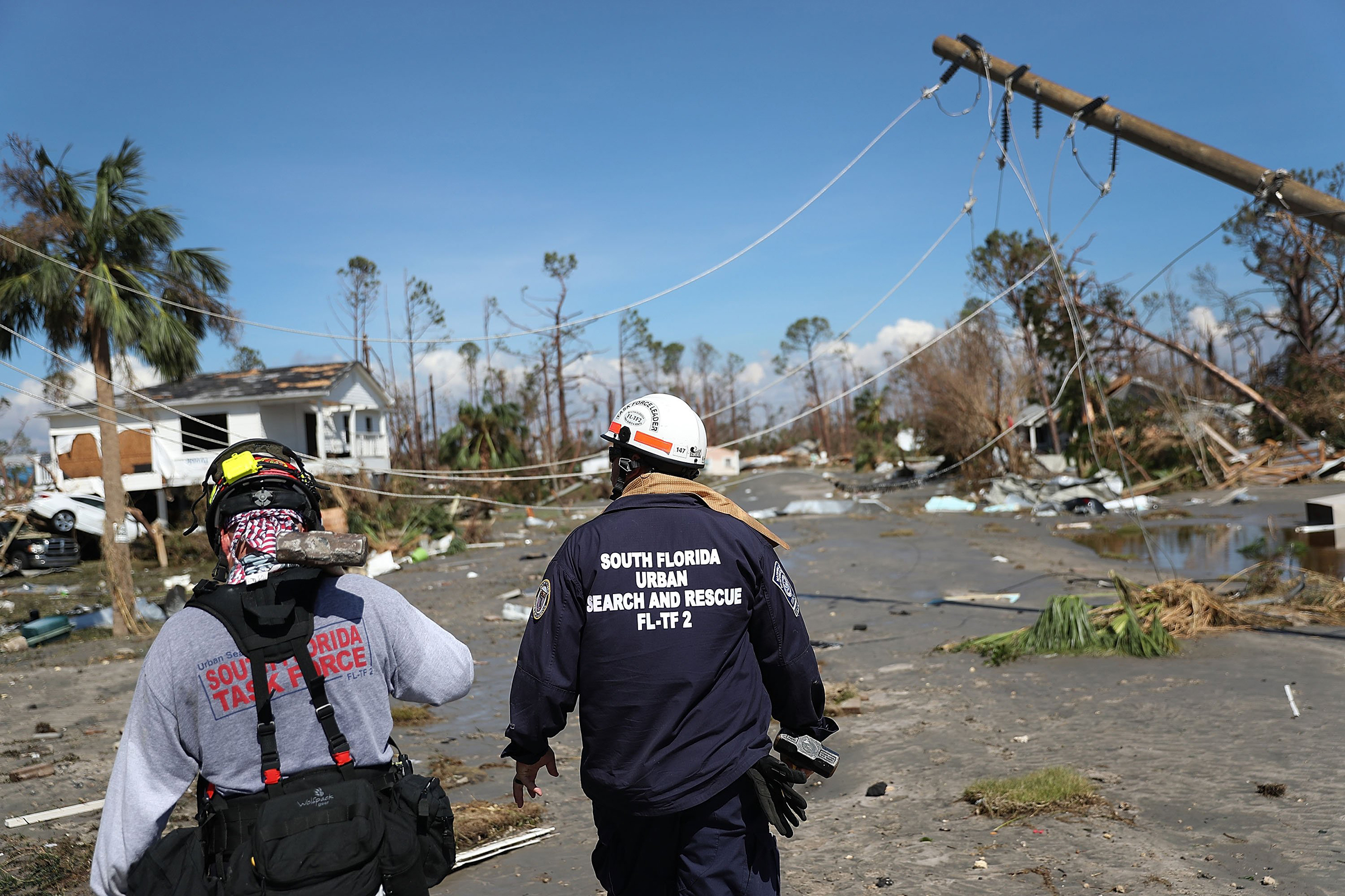 Members of the South Florida Search and Rescue team search for survivors in the destruction left after Hurricane Michael passed through the area on Oct. 11, 2018 in Mexico Beach, Fla.