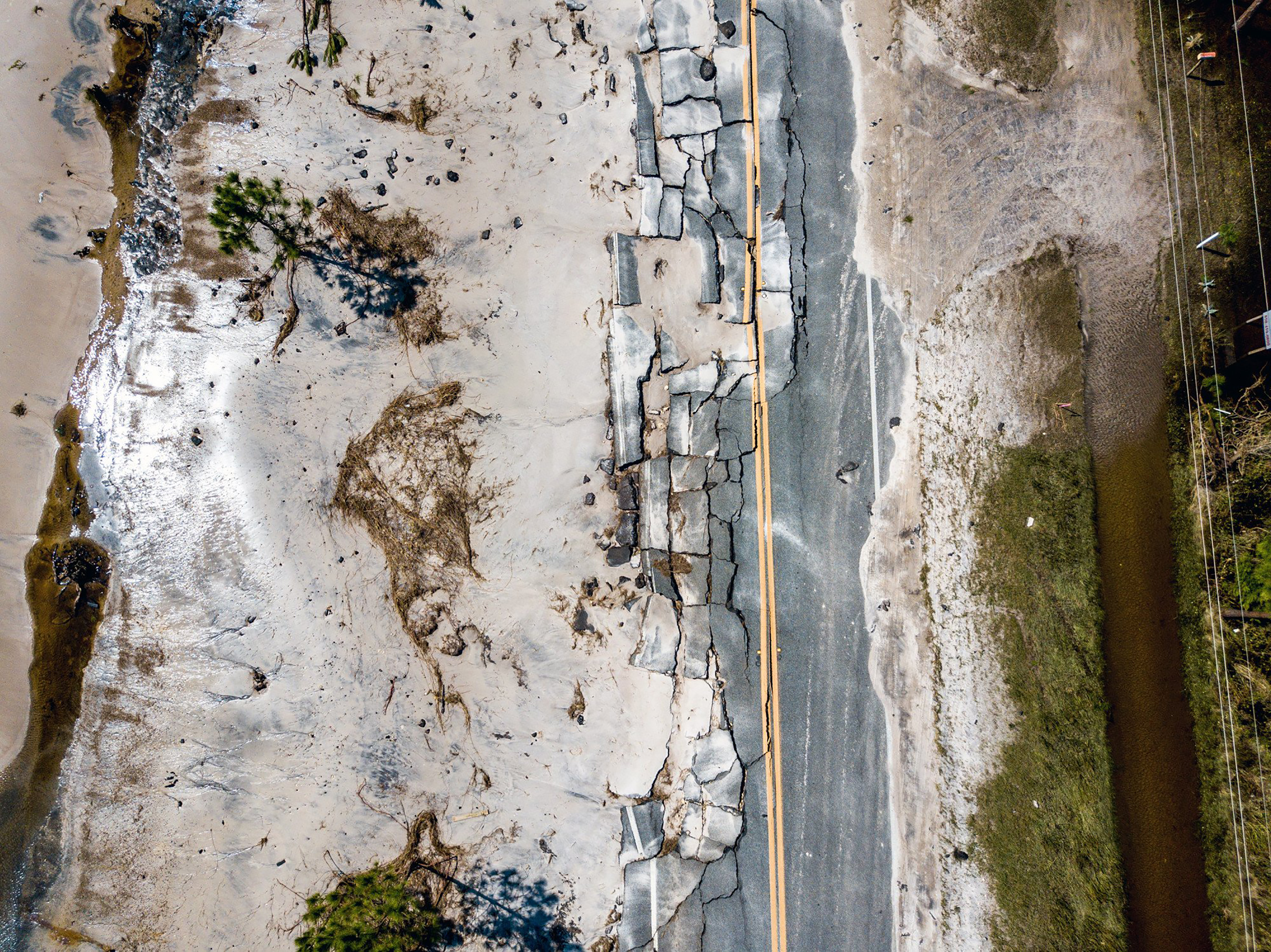 The power of Hurricane Michael's storm surge is evidenced by the damage done to State Road 98, which runs along the Gulf Coast in Carrabelle, Fla., on Oct. 11, 2018.