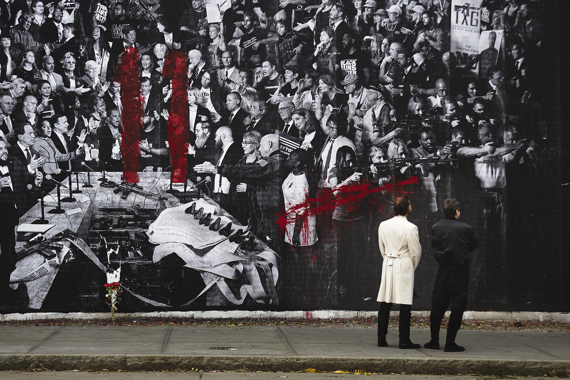 A red spray painted number 11, an apparent reference to the individuals slain in Pittsburgh, is seen on the  Guns in America  mural created by TIME and the artist JR on the Houston Bowery Wall in New York City.