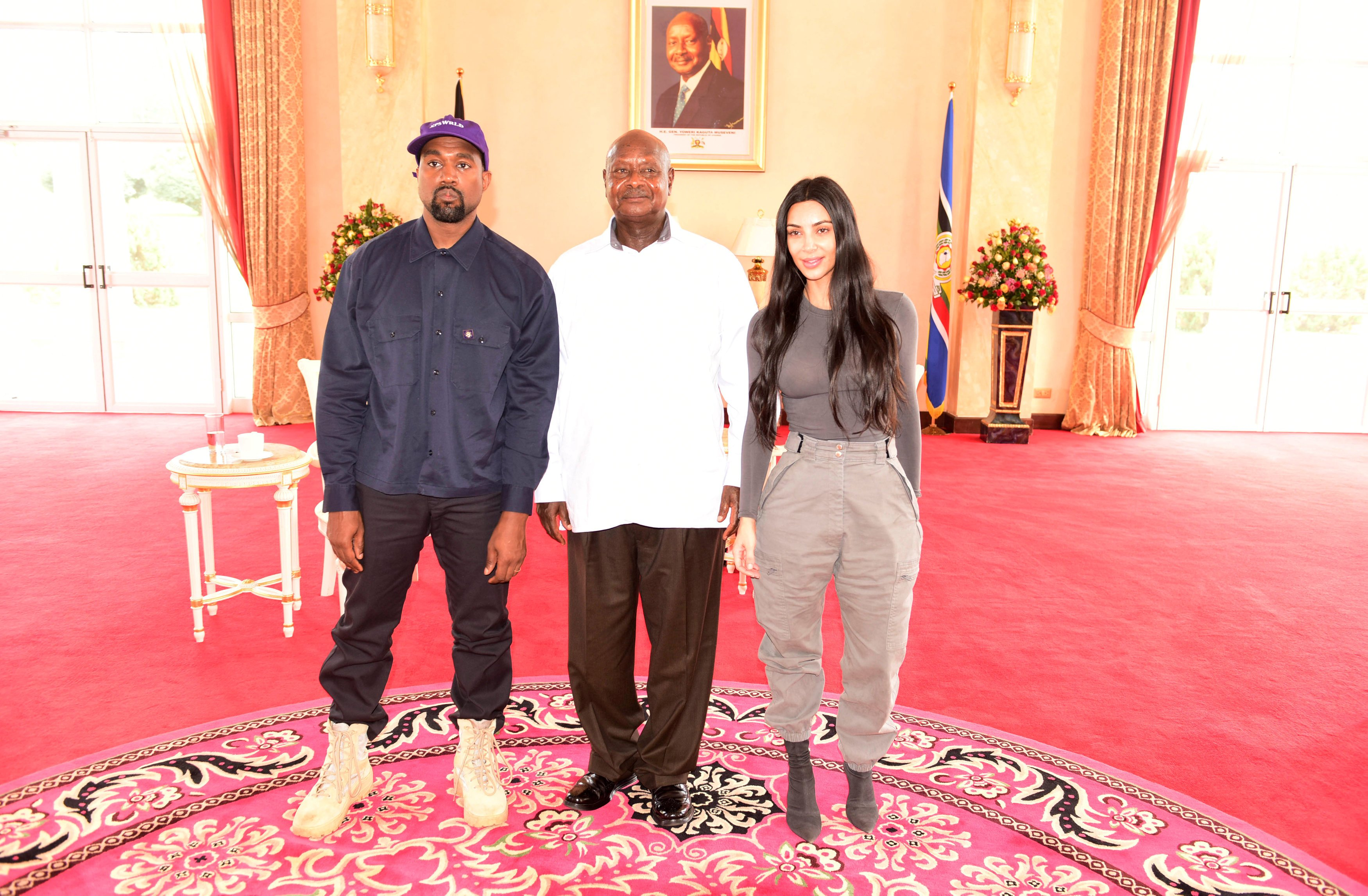 Rapper Kanye West (L) and Kim Kardashian (R) pose for a photograph with Uganda's President Yoweri Museveni when they paid a courtesy call at State House, Entebbe, Uganda October 15, 2018. Uganda's Presidential Press Office/HO/AFP/Getty Images