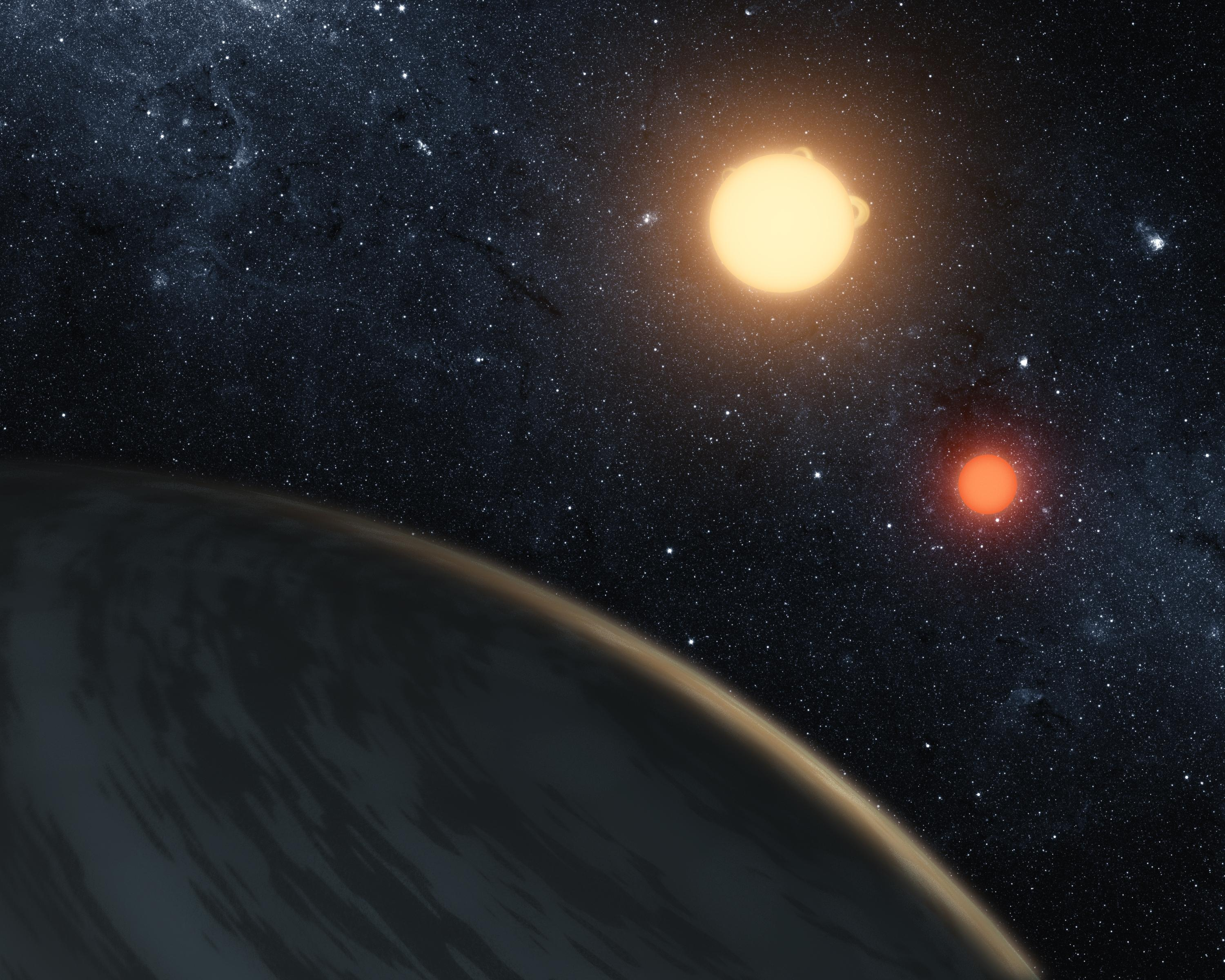This artist's concept obtained October 30, 2018 courtesy of NASA/Ames/JPL-Caltech/T. Pyle, shows Kepler-16b, the first planet around a double-star system.