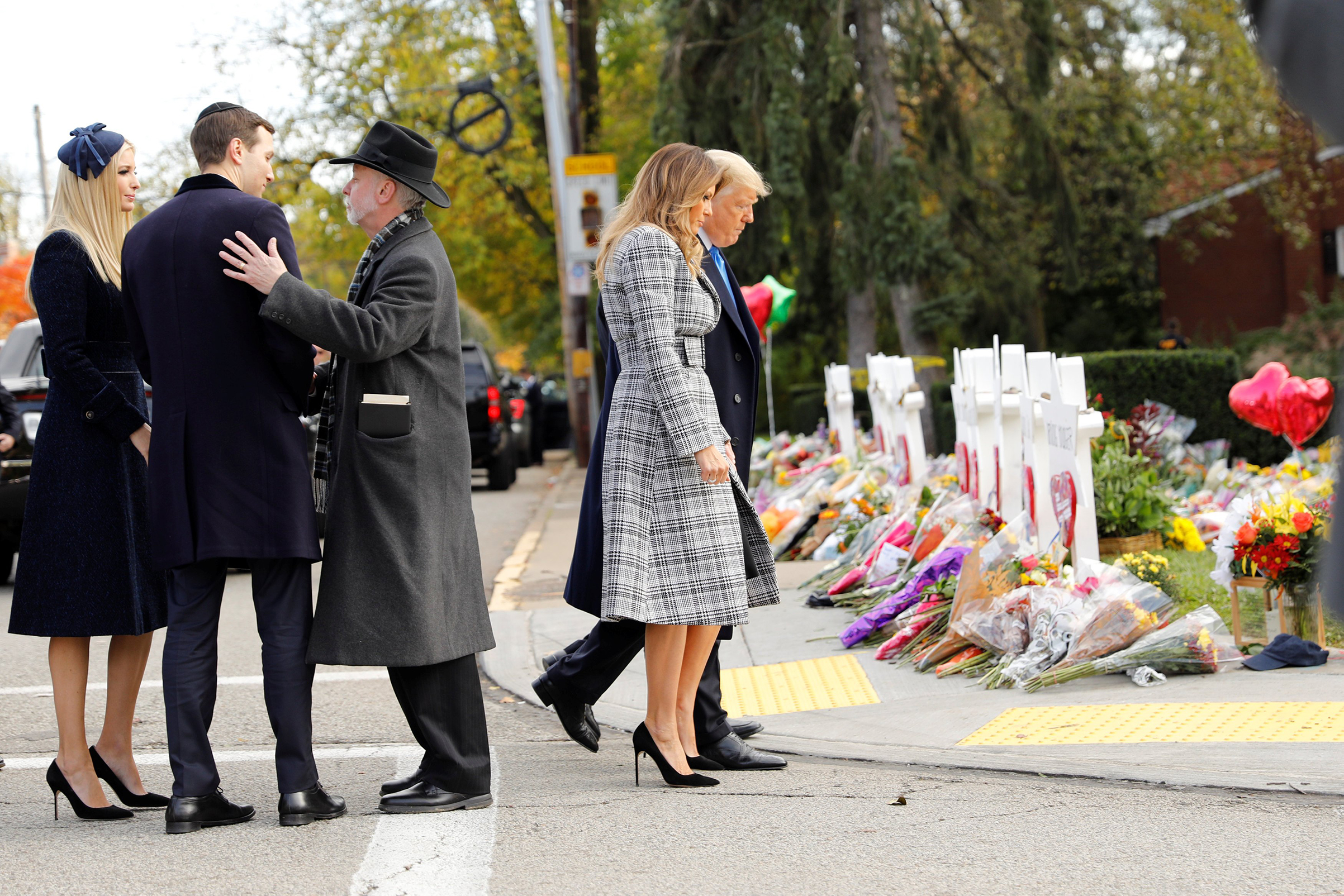 White House senior advisers Jarod Kushner and Ivanka Trump speak with Rabbi Jeffrey Myers as President Donald Trump and first lady Melania Trump pay their respects outside the Tree of Life synagogue in Pittsburgh, Oct. 30.