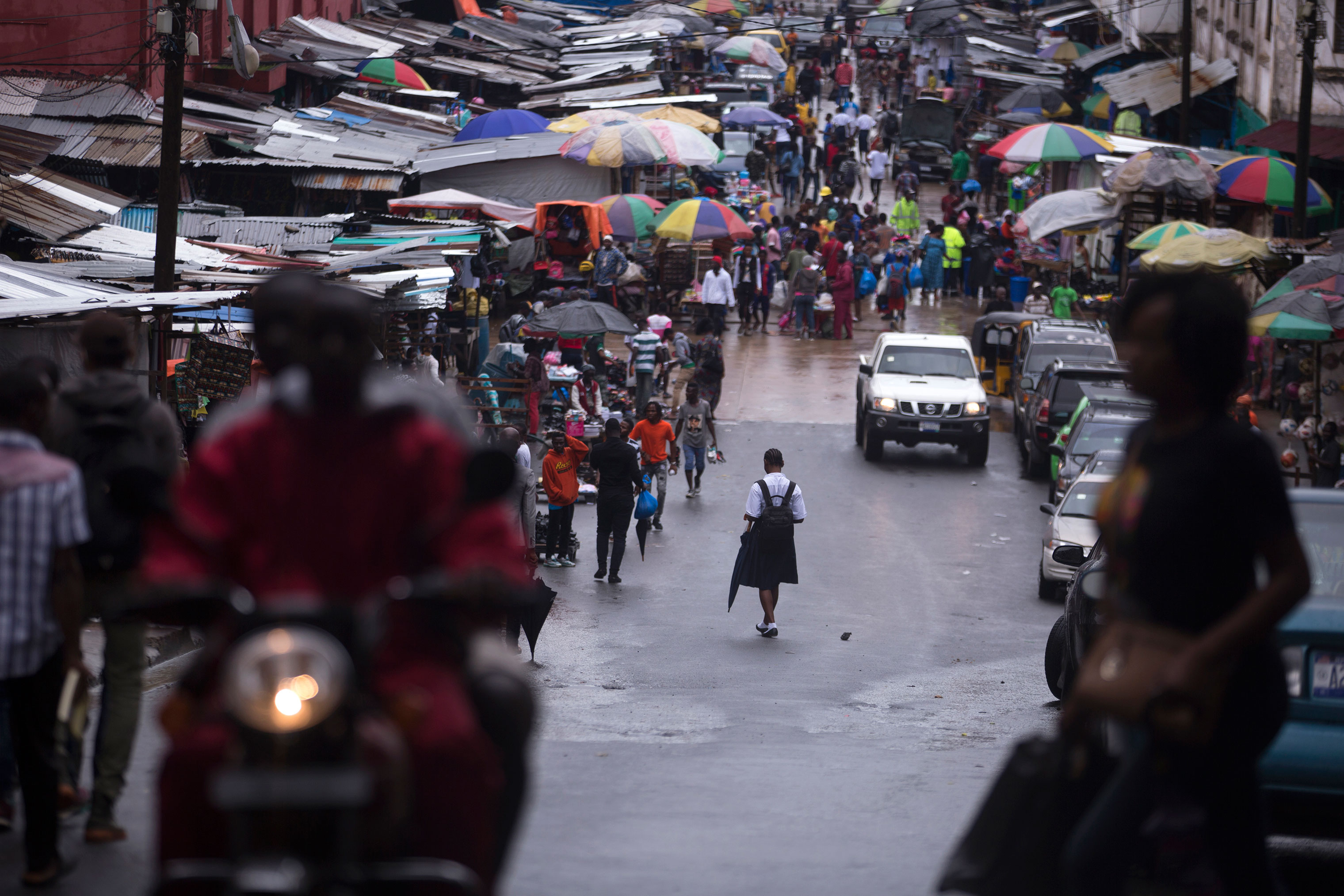 A school girl walks towards Waterside Market in Monrovia.