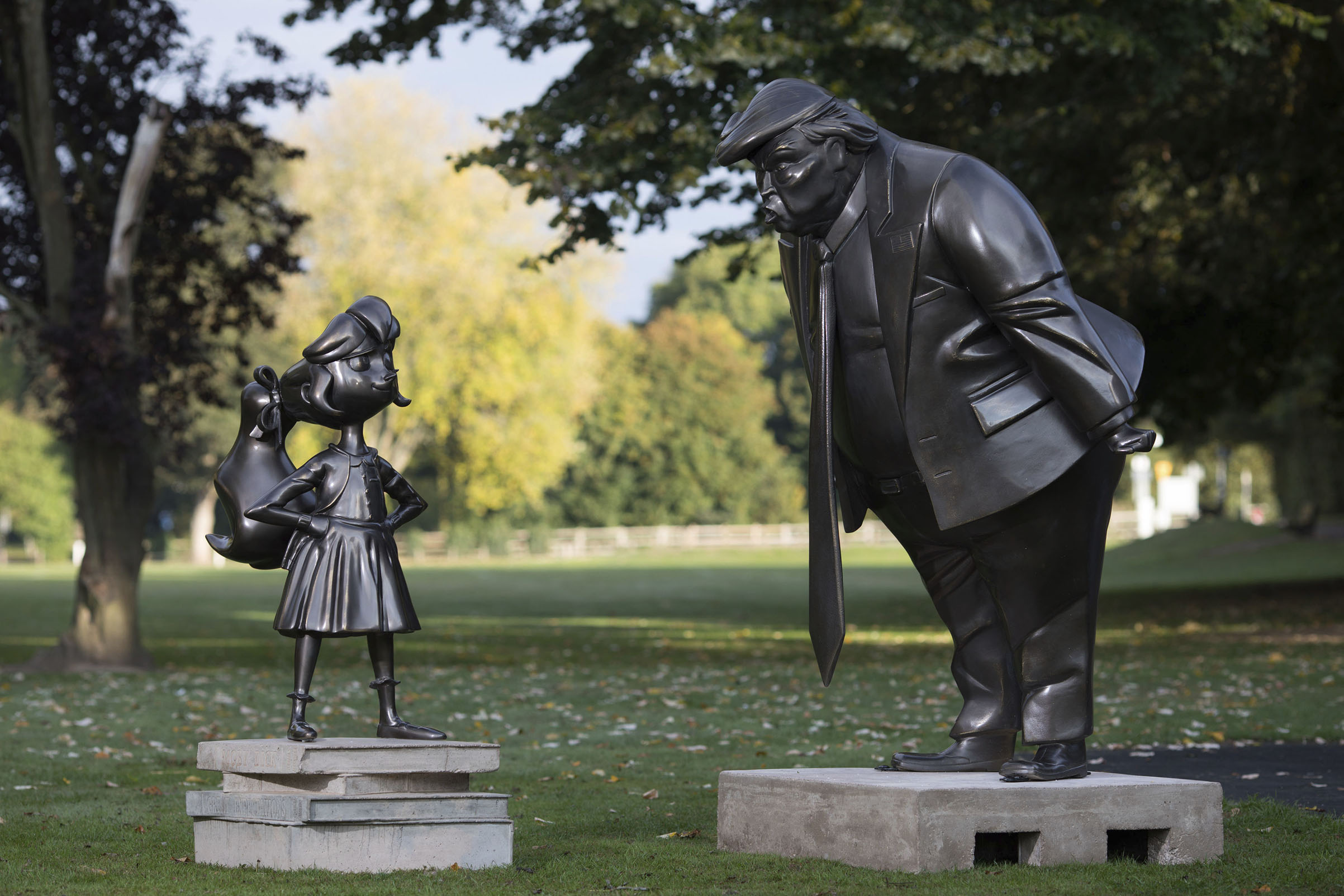 A statue of Roald Dahl's Matilda is unveiled in Great Missenden in Buckinghamshire, alongside one of President Donald Trump, to celebrate the 30th Anniversary of Matilda the novel.