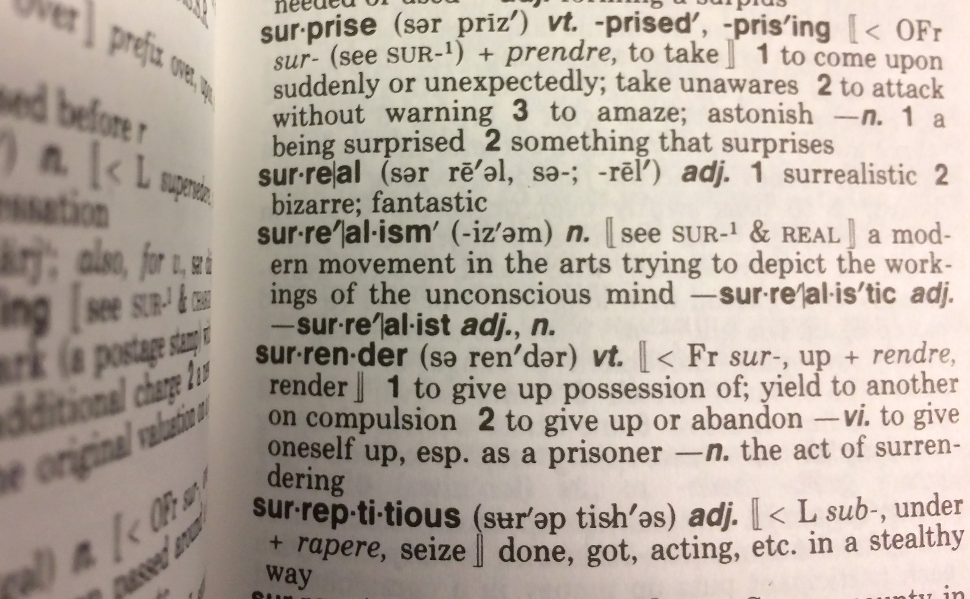 This December 16, 2016 photo illustration taken in Washington, DC. shows the definition for the word  Surreal  in a copy of the Webster's Desktop Dictionary.                       Donald Trump's upset win in the US presidential election astonished people so much that they rushed to the dictionary to look up the word everyone was using to describe the event: surreal. Indeed, Merriam-Webster's dictionary on Monday named surreal its Word of the Year 2016, the honor given to the word or term with the sharpest spike in look-ups over the previous year.                        / AFP / Karen BLEIER        (Photo credit should read KAREN BLEIER/AFP/Getty Images)