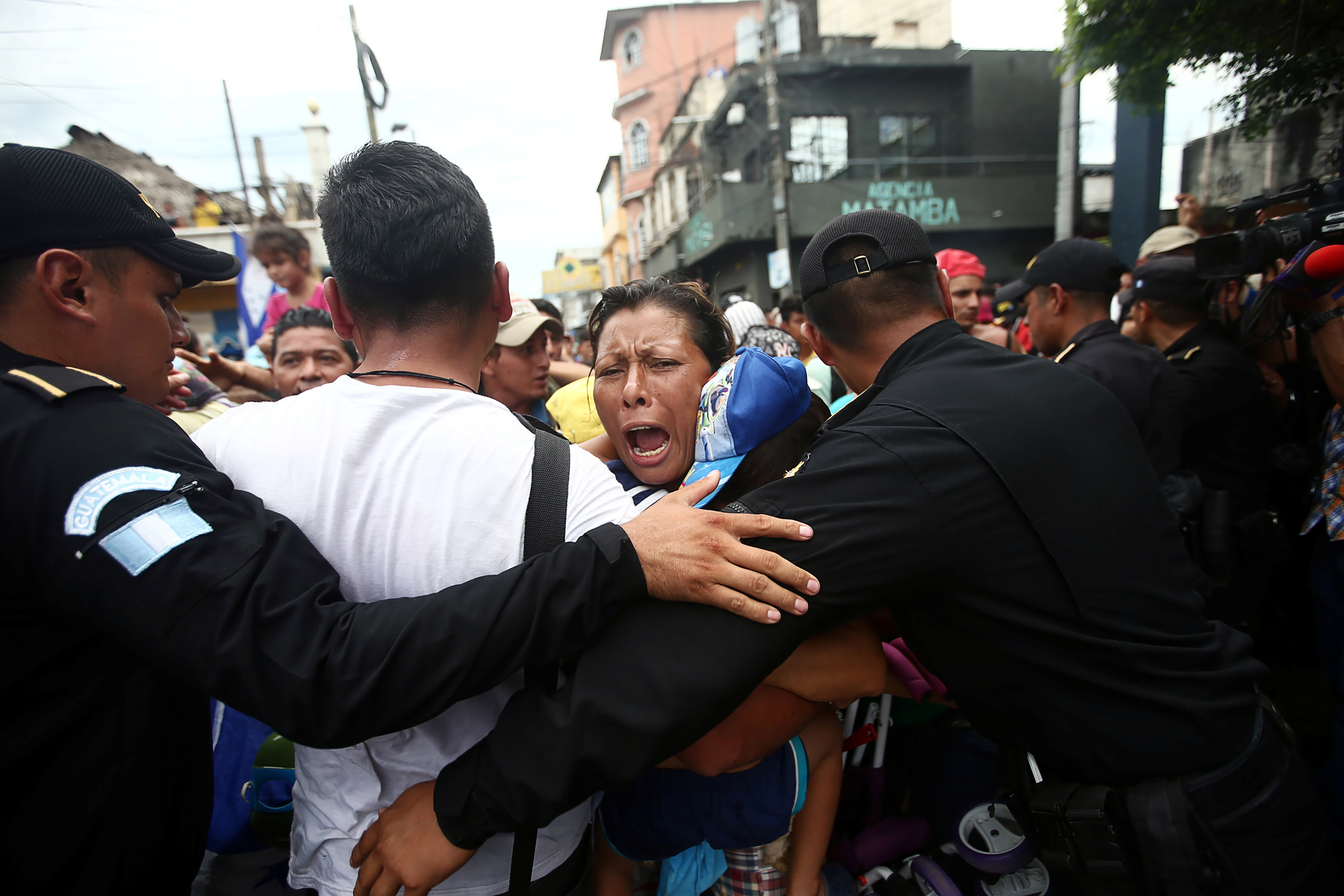 A Honduran migrant reacts as she storms the checkpoint between Guatemala and Mexico in Tecun Uman, Guatemala, on Oct. 19.