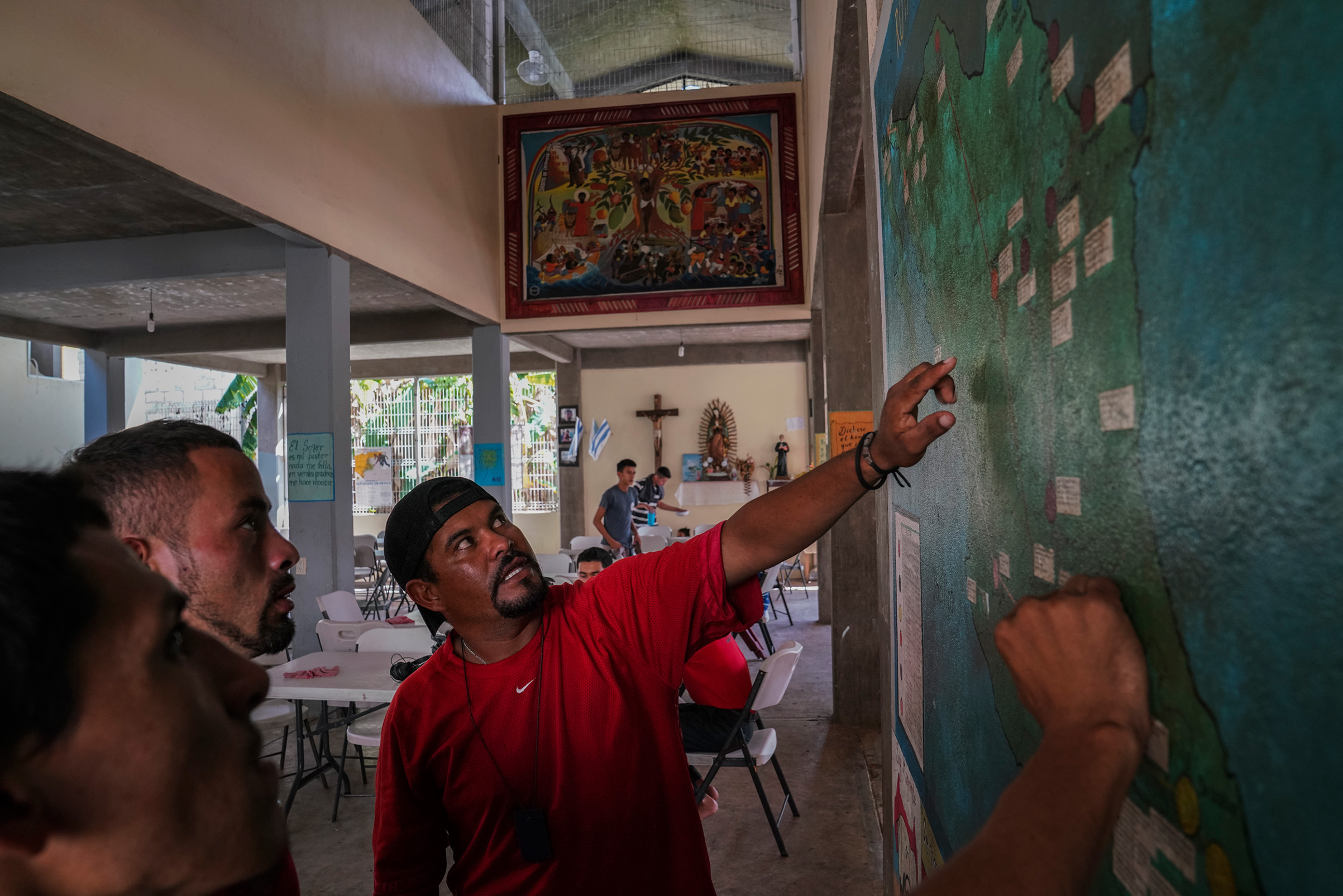 Miguel Alvarado, 36, explains the different routes that migrants can take at a shelter near Palenque, Chiapas, on Oct. 20. Miguel plans to work in the U.S. to be able to support his three kids who he left behind. He had heard about the caravan that is currently traveling through Mexico, but he decided not to join it because he is afraid they will soon be stopped.