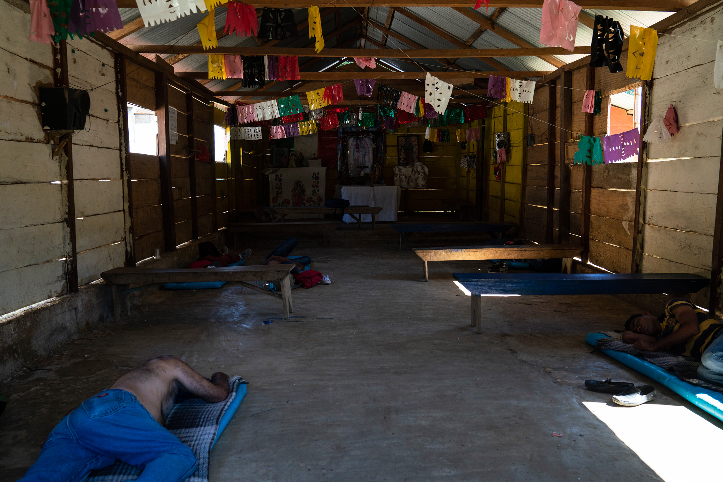 Honduran migrants Juan Ramón Andino, 60, left and José, 40, right, sleep in a church that also serves as a migrant shelter in General Emiliano Zapata del Valle near Palenque, Chiapas, on Oct. 24. The shelter is located along highway 307, known as  The Great Pacific Corridor of the Migrant,  and is a common route for Honduran migrants.