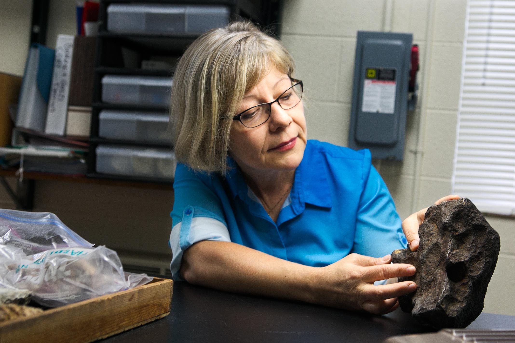 Central Michigan University Professor Mona Sirbescu shows off a meteorite