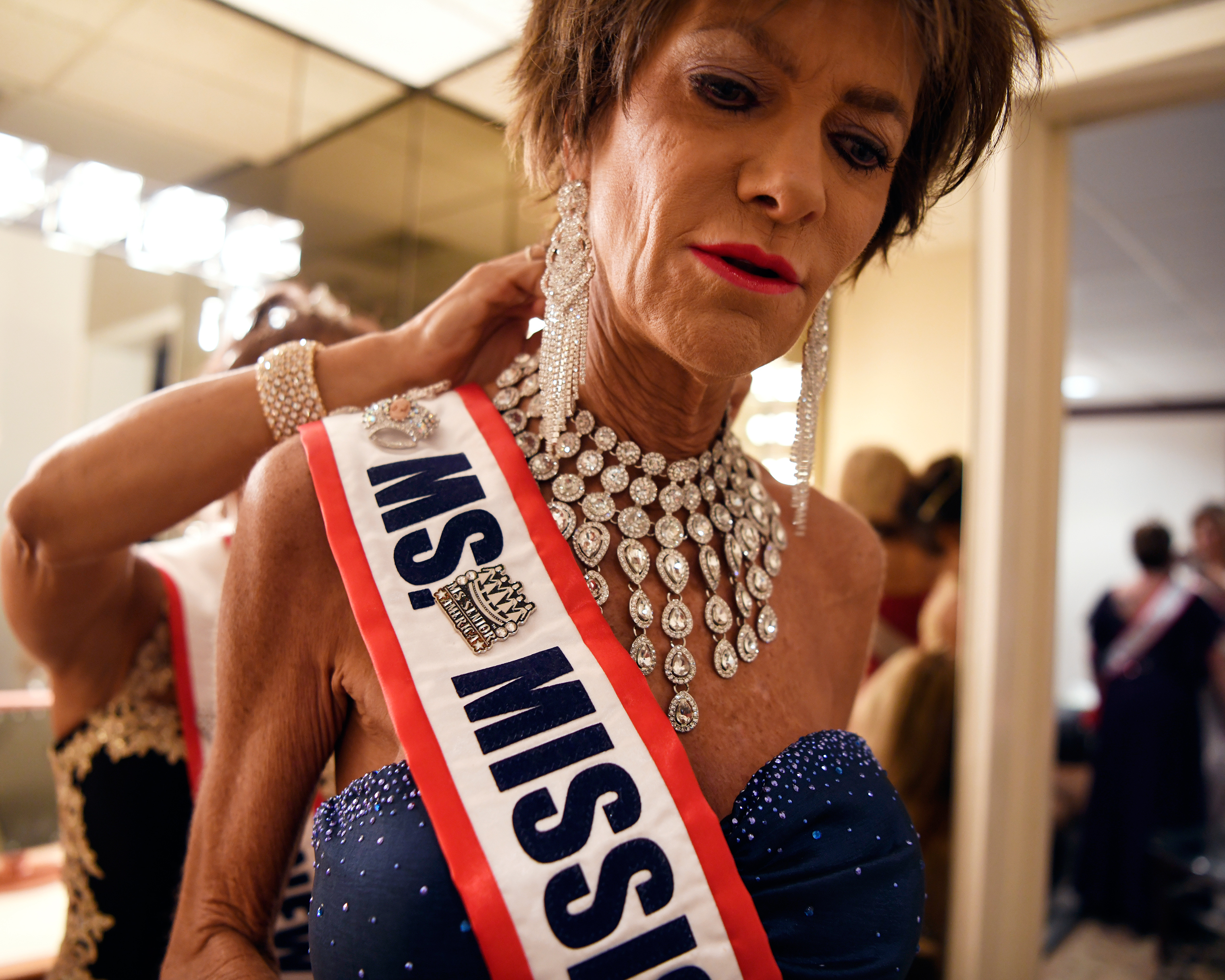 Mary Jane Lawler, Ms. Mississippi, gets ready before the Ms. Senior America Pageant finale.
