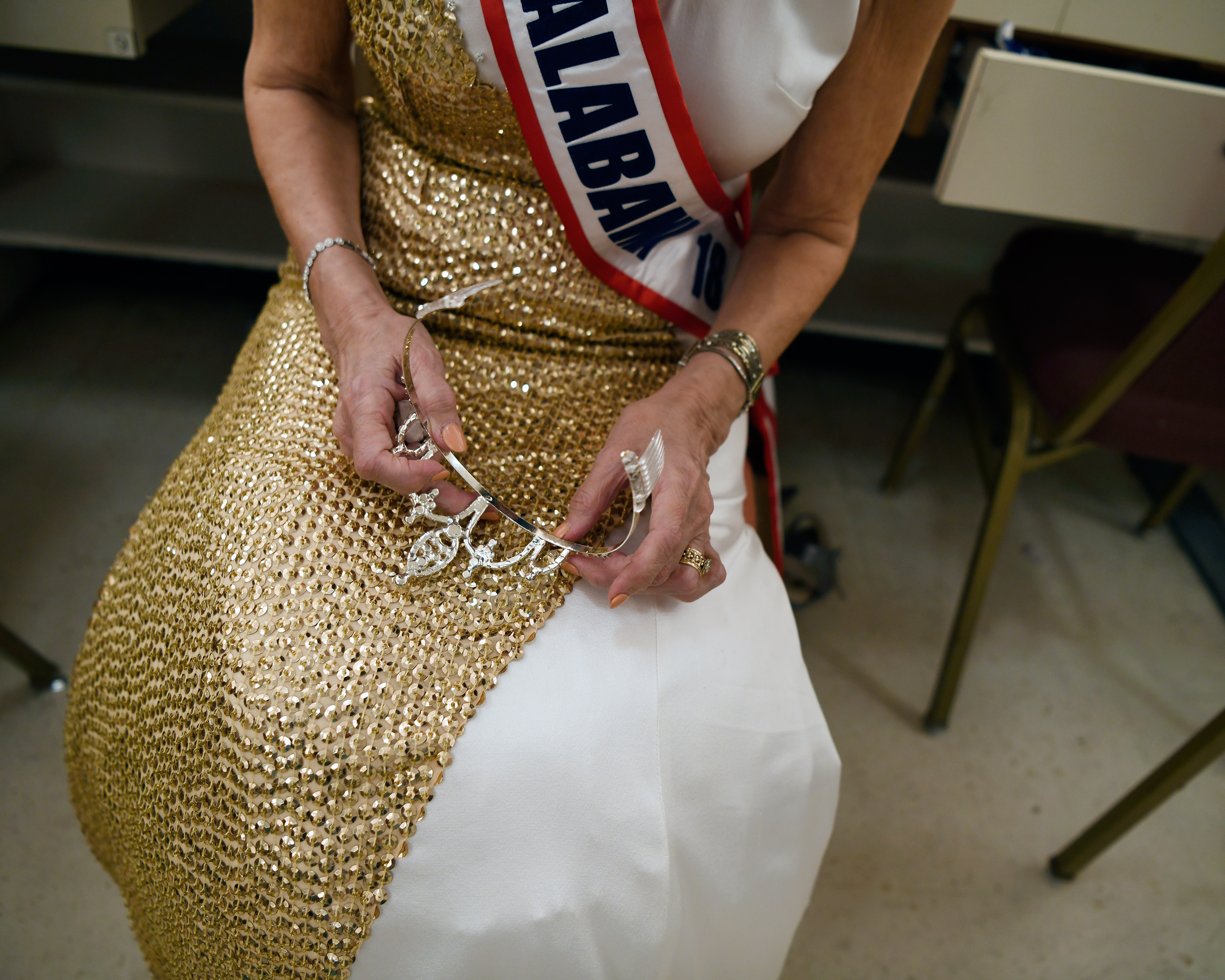 Georgia Lee, Ms. Alabama, holds her crown in the dressing room between pageant acts.