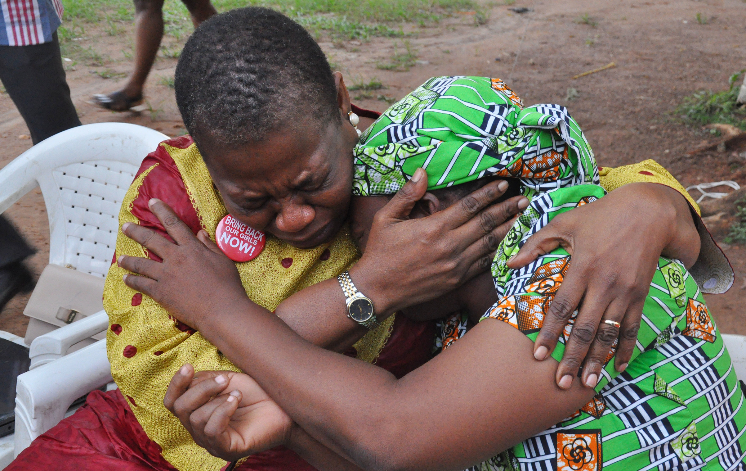 Ezekwesili comforts the mother of a girl kidnapped by Boko Haram in Abuja on Aug. 14, 2016