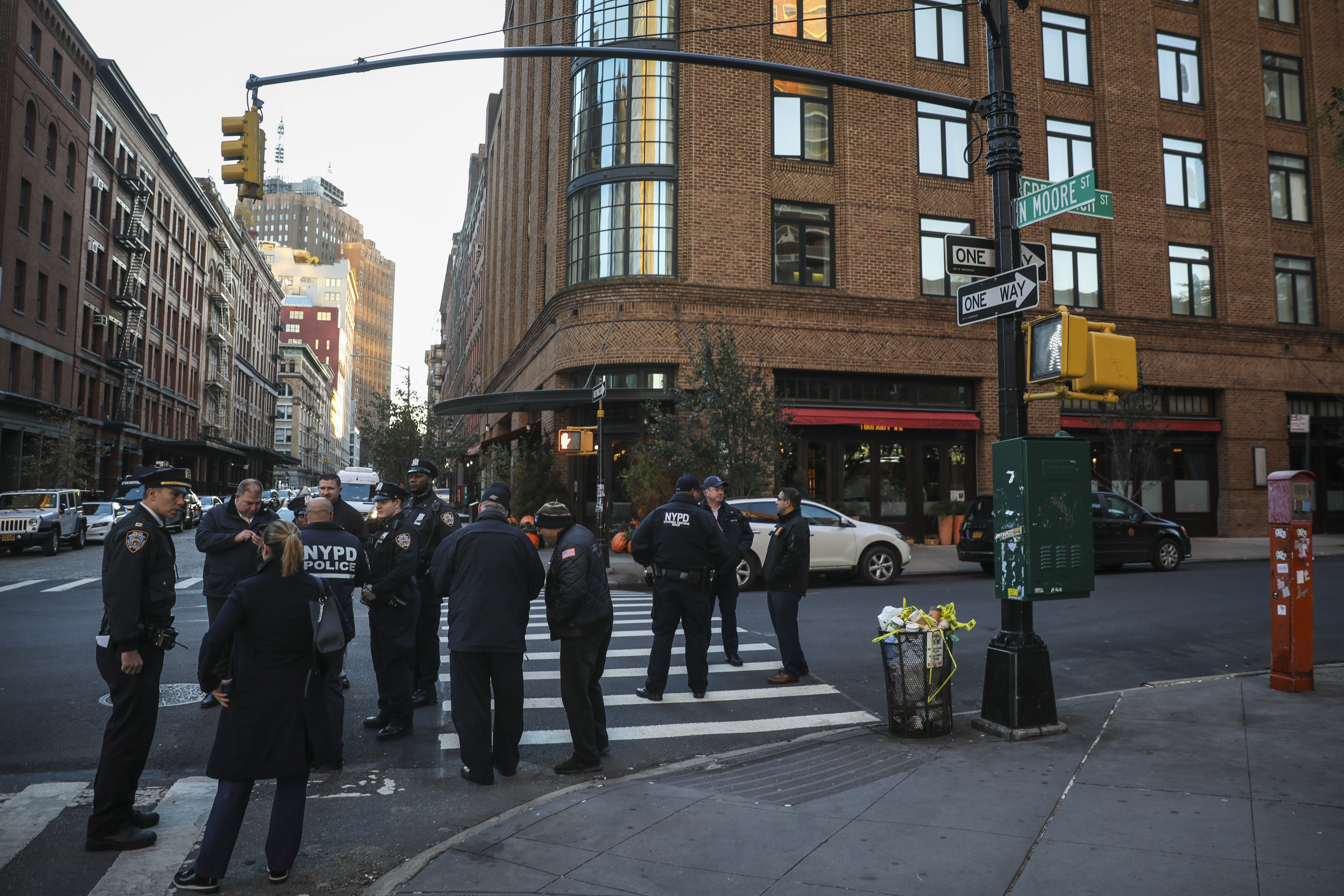Police gather near the scene of where another package bomb was found early Thursday morning at Robert De Niro's Tribeca Grill restaurant, October 25, 2018 in New York City.
