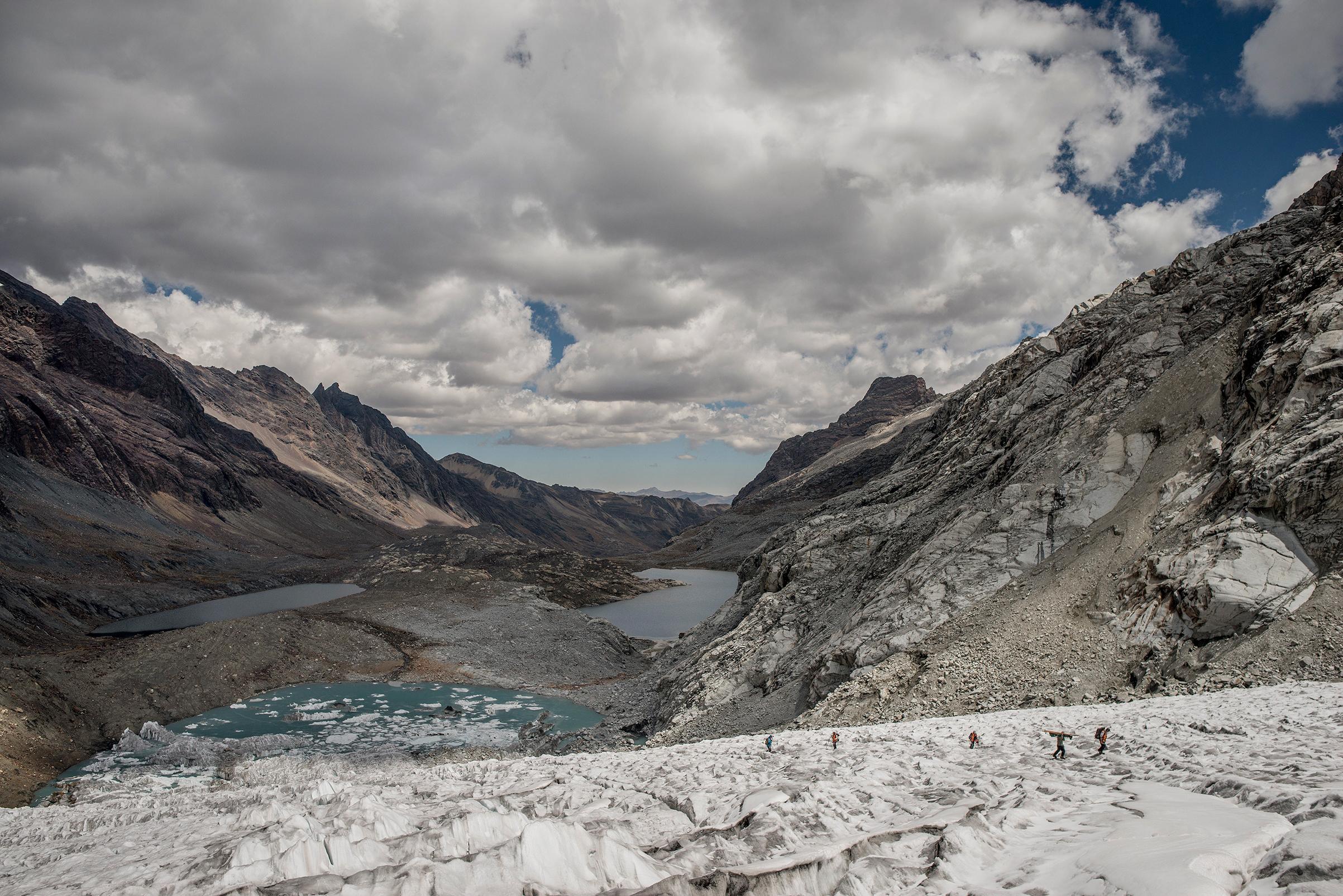Researchers work on the Gueshgue glacier in the Cordillera Blanca region in August 2017.