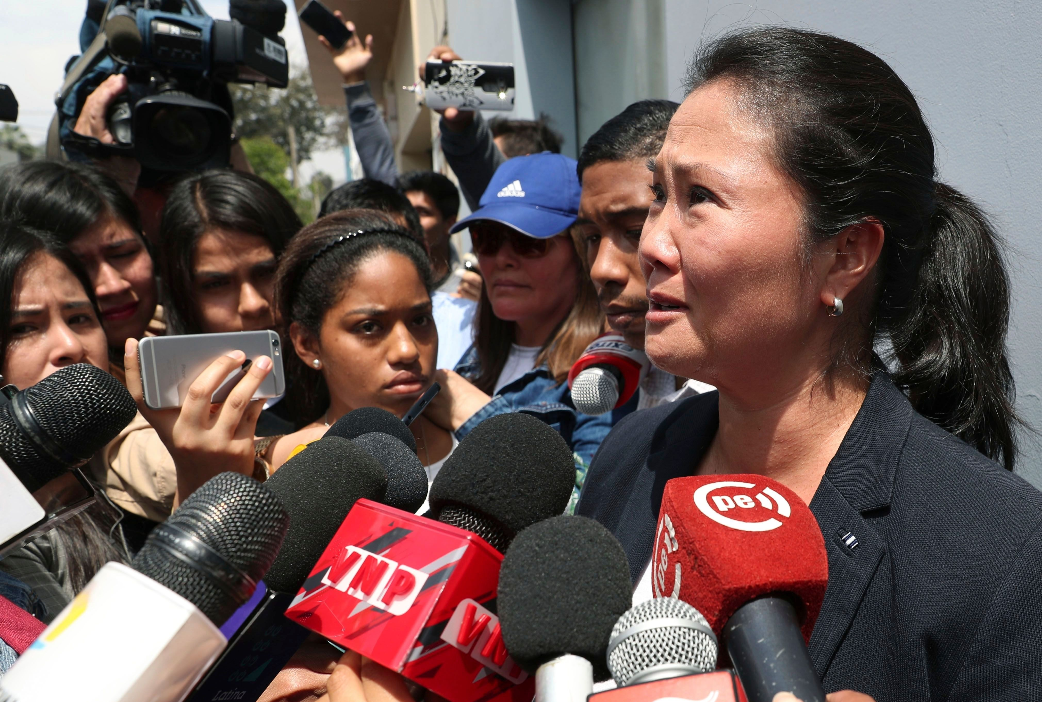 Keiko Fujimori, daughter of Peru's former President Alberto Fujimori, cries as she speaks with reporters outside of her father's home in Lima, Peru, on Oct. 3. Peru's Supreme Court has overturned a medical pardon for former President Alberto Fujimori and ordered the strongman be returned to jail to serve out a long sentence for human rights abuses. On Wednesday, Keiko Fujimori was detained as a result of a campaign finance probe.