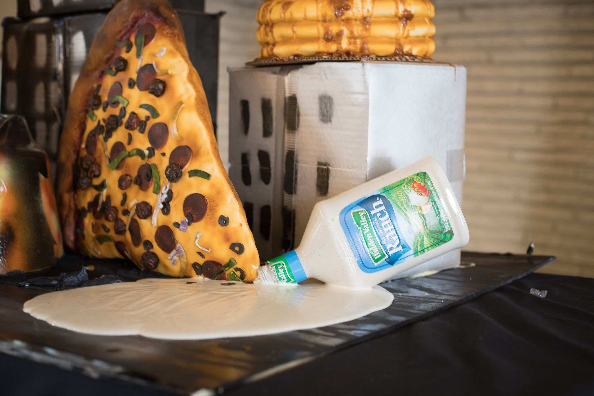 Guy Fieri style ranch fountain and pizza cake for dipping.