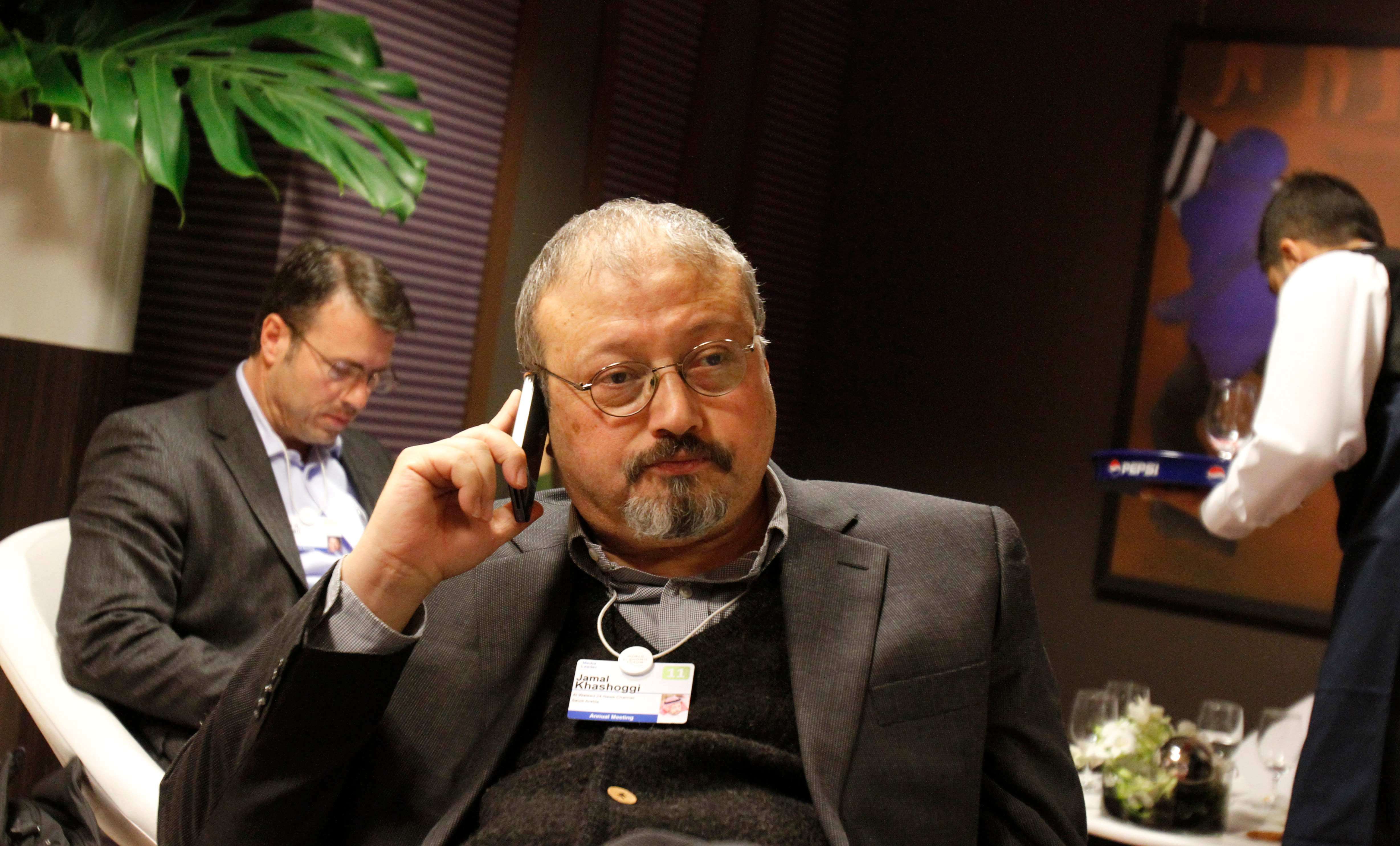 In this file photo, Jamal Khashoggi, a Saudi Arabian journalist, speaks on his cellphone at the World Economic Forum in Davos, Switzerland, on Jan. 29, 2011