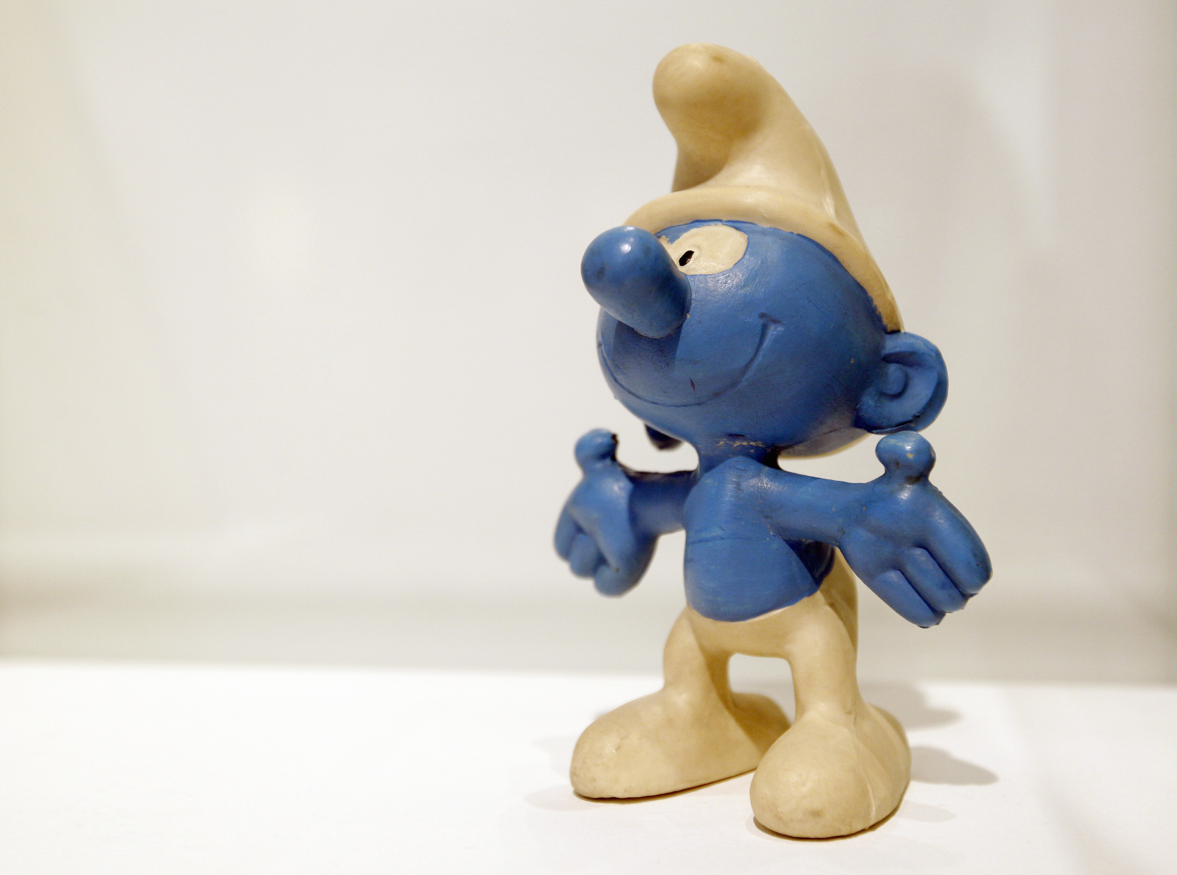 A Smurf (Schtroumpf in French) is displayed during an exhibition entitled  Pierre Culliford, PEYO, the life and and work of a master story-teller  at the Artcurial's saleshouse on July 7, 2011, in Paris. The retrospective showcased over 150 original works, archive material and personal items from Peyo.