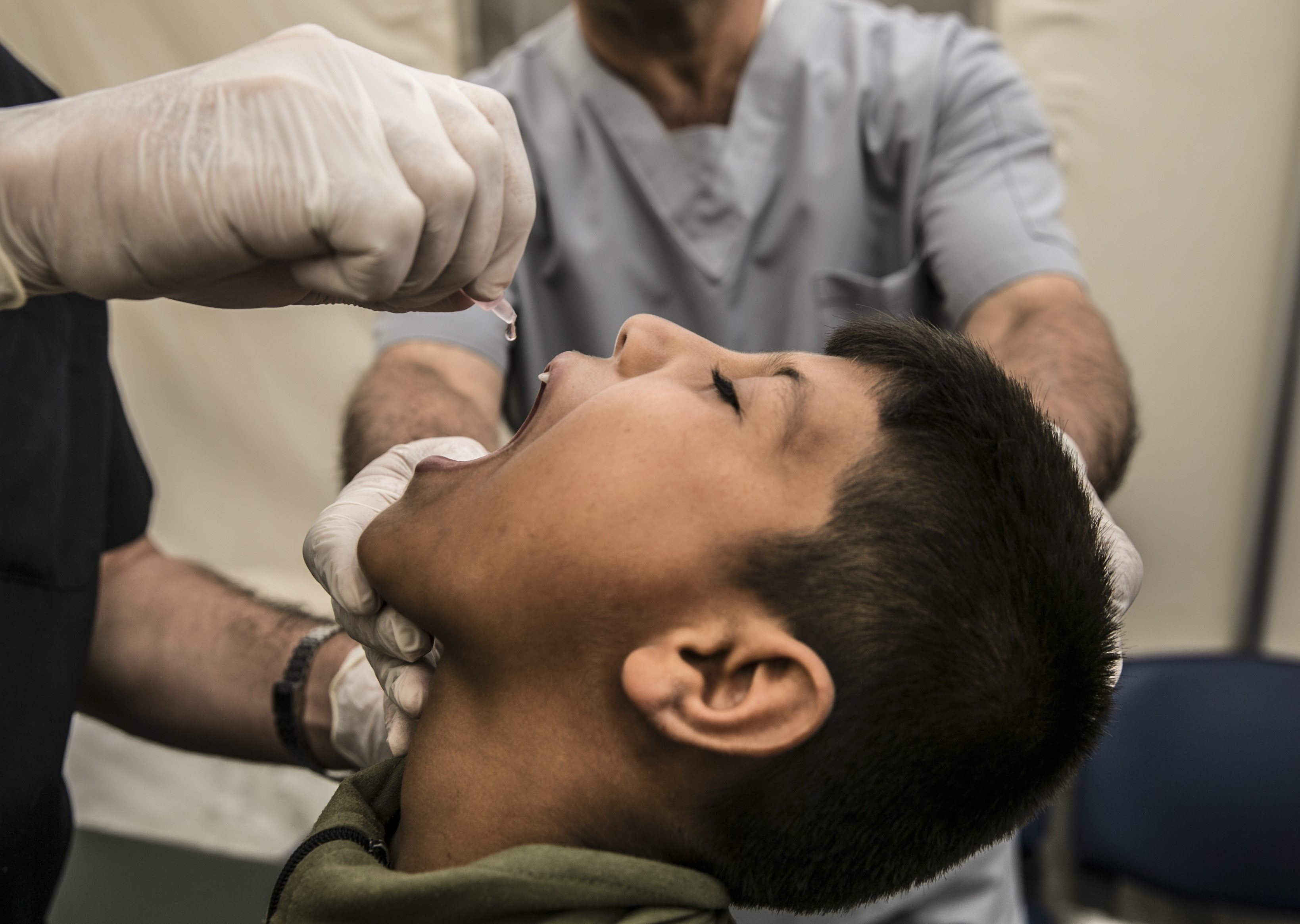 A Syrian child receives vaccination during polio, measles mumps vaccination campaign for Syrian children at Bab al-Hawa Border Crossing and Cilvegozu Border Gate in Reyhanli district of Hatay on October 01, 2018. Syrian children received vaccination before entering Turkey on their return from Syria after leaving for visits during feast of sacrifice.