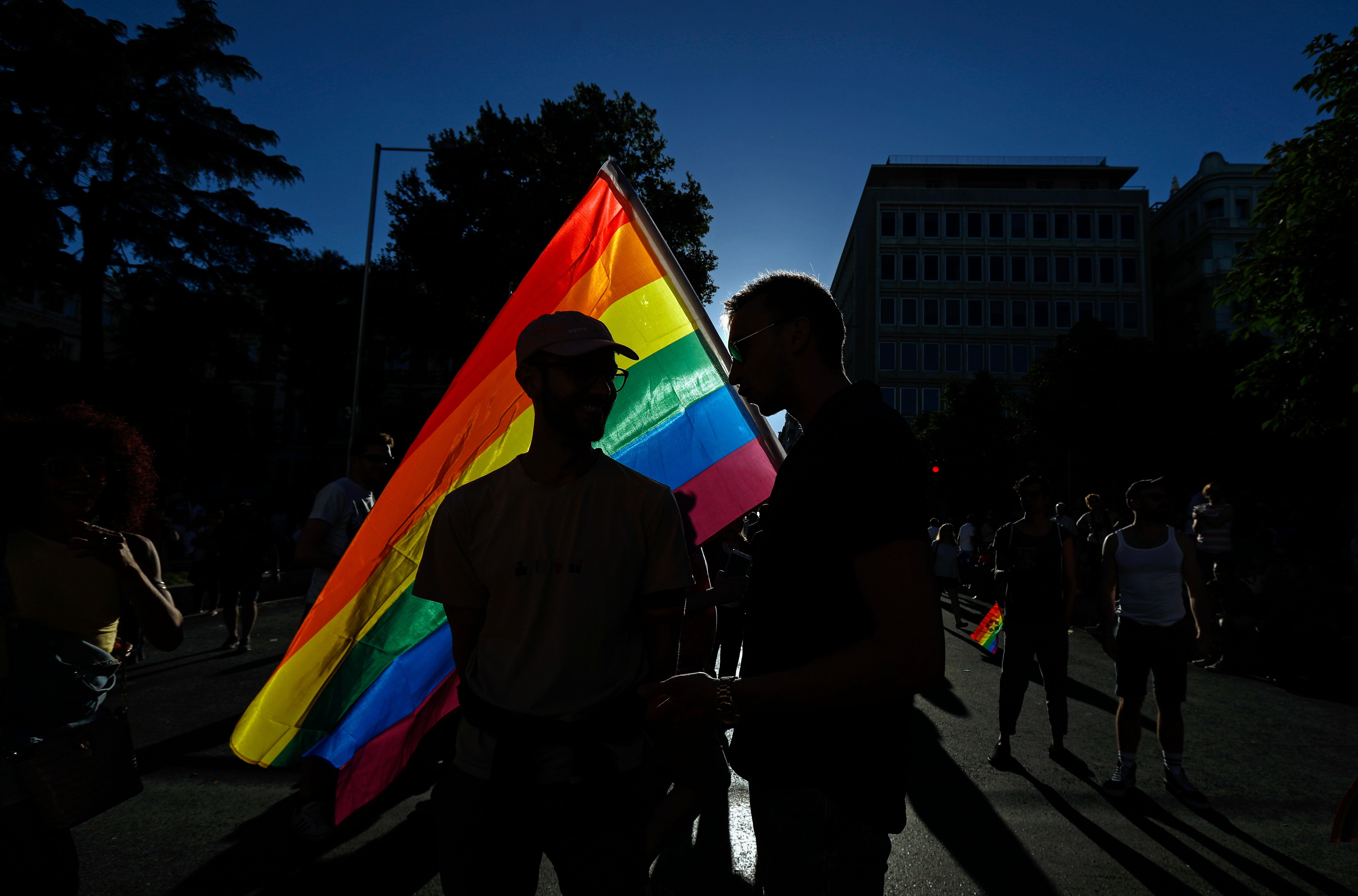 Participants hold a rainbow flag during the WorldPride 2017 parade in Madrid on July 1, 2017.                 Revellers took to the rainbow streets of Madrid today in the world's biggest march for gay, lesbian, bisexual and transgender rights.