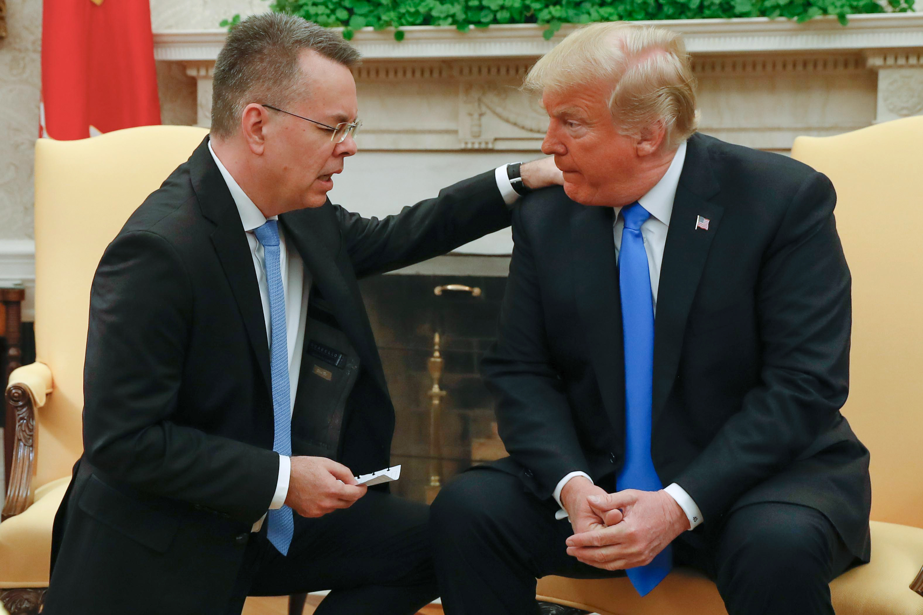 Freed American pastor Andrew Brunson prays for President Donald Trump at the White House in Washington, DC, October 13, 2018.